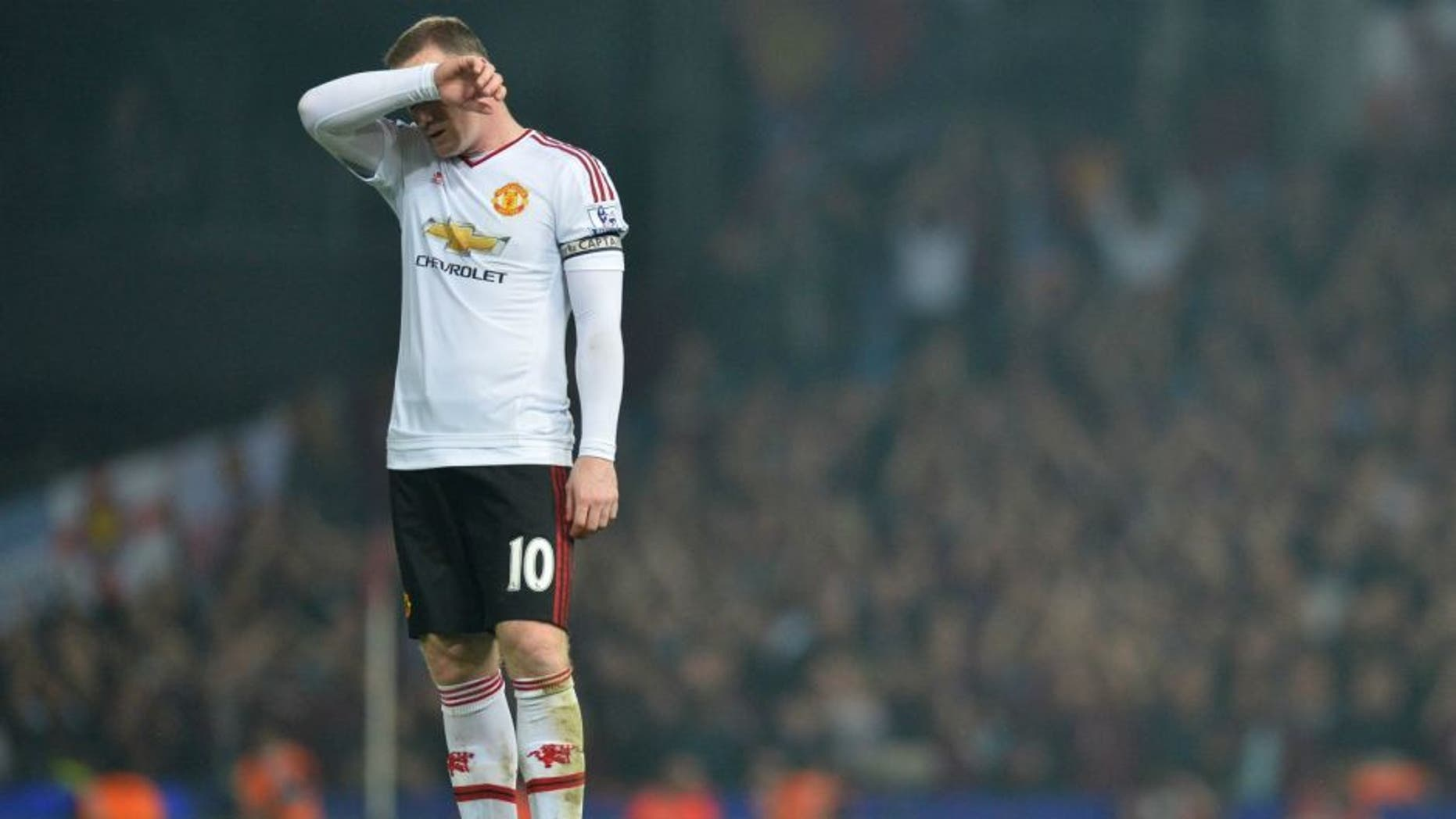 Manchester United's English striker Wayne Rooney reacts after losing the English Premier League football match between West Ham United and Manchester United at The Boleyn Ground in Upton Park, in east London on May 10, 2016. / AFP / GLYN KIRK / RESTRICTED TO EDITORIAL USE. No use with unauthorized audio, video, data, fixture lists, club/league logos or 'live' services. Online in-match use limited to 75 images, no video emulation. No use in betting, games or single club/league/player publications. / (Photo credit should read GLYN KIRK/AFP/Getty Images)