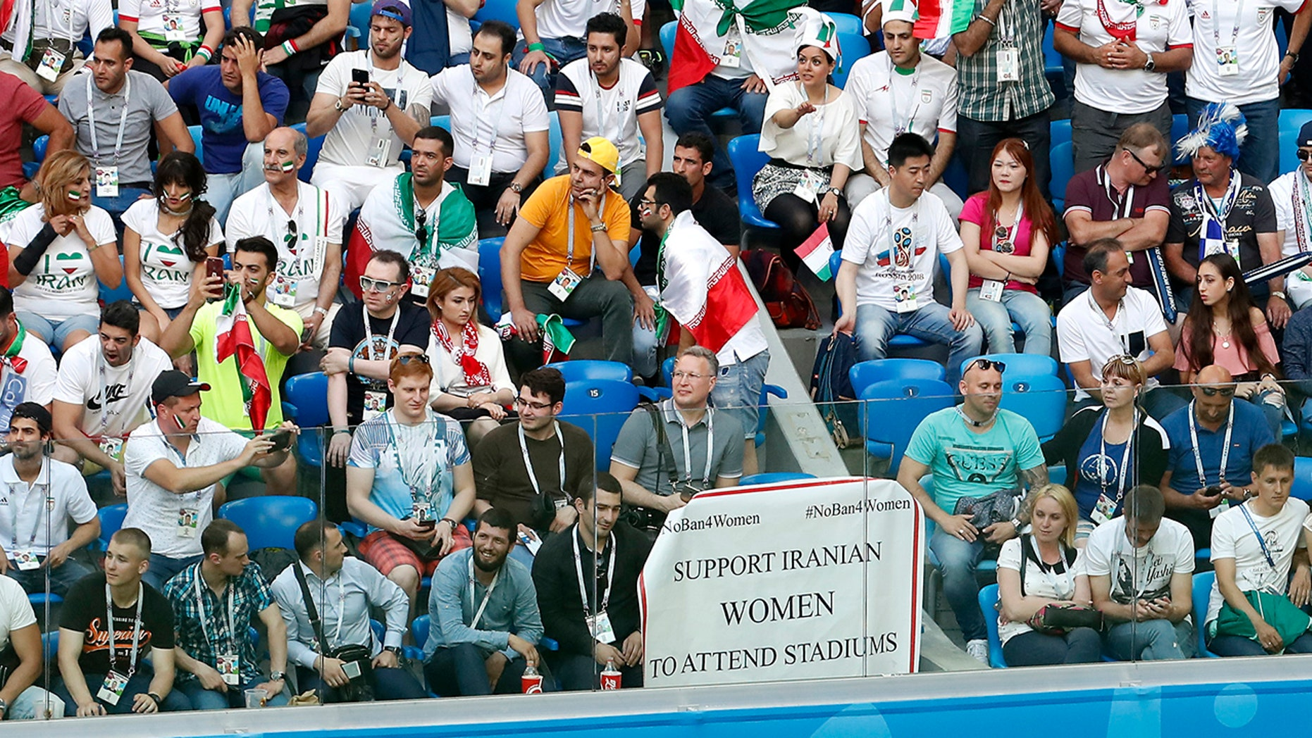 A poster to support Iranian women is displayed in the stands during the group B match between Morocco and Iran at the 2018 soccer World Cup in the St. Petersburg Stadium in St. Petersburg, Russia.
