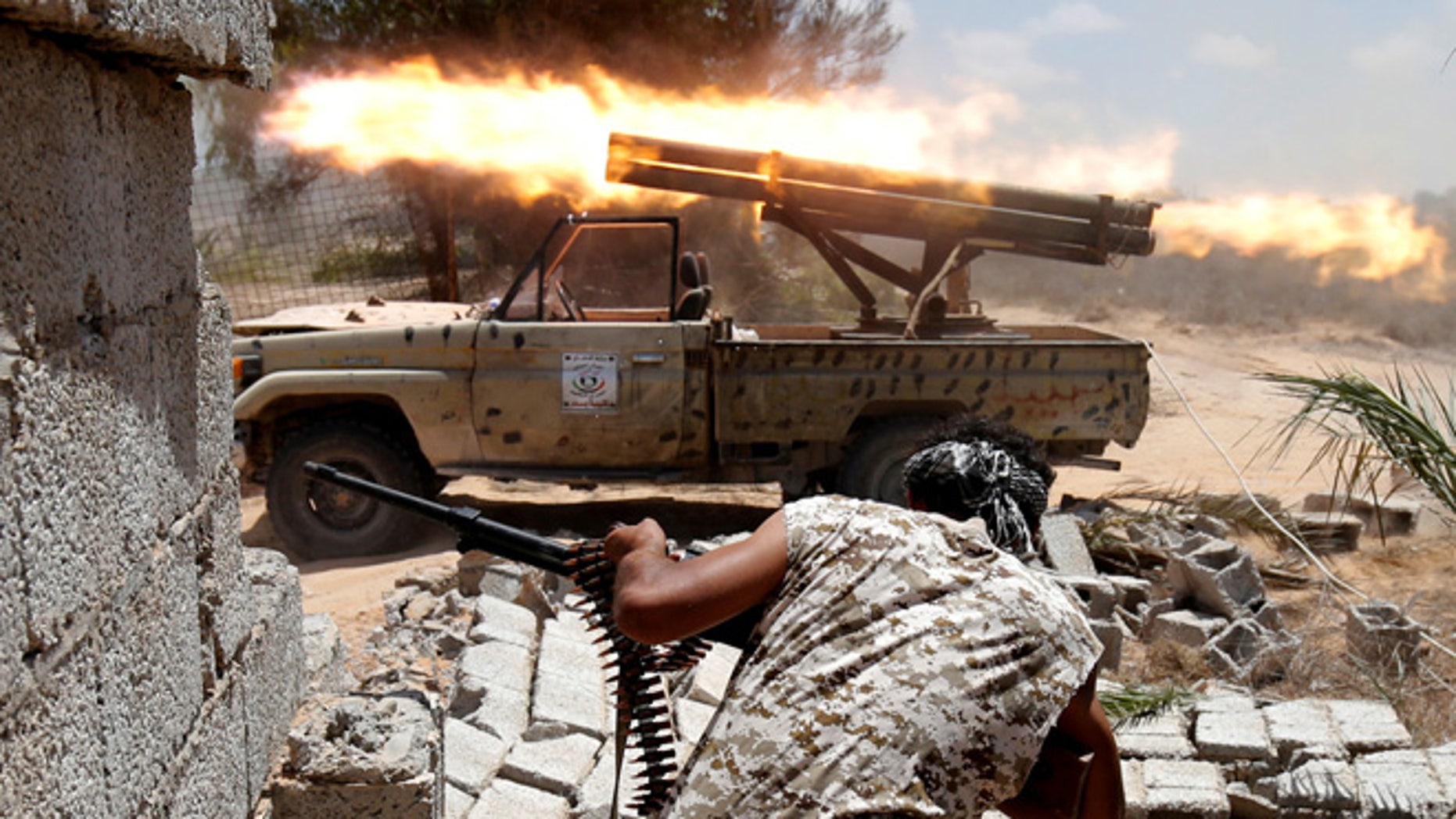 July 31: Libyan forces allied with the U.N.-backed government fire weapons during a battle with ISIS fighters in Sirte.