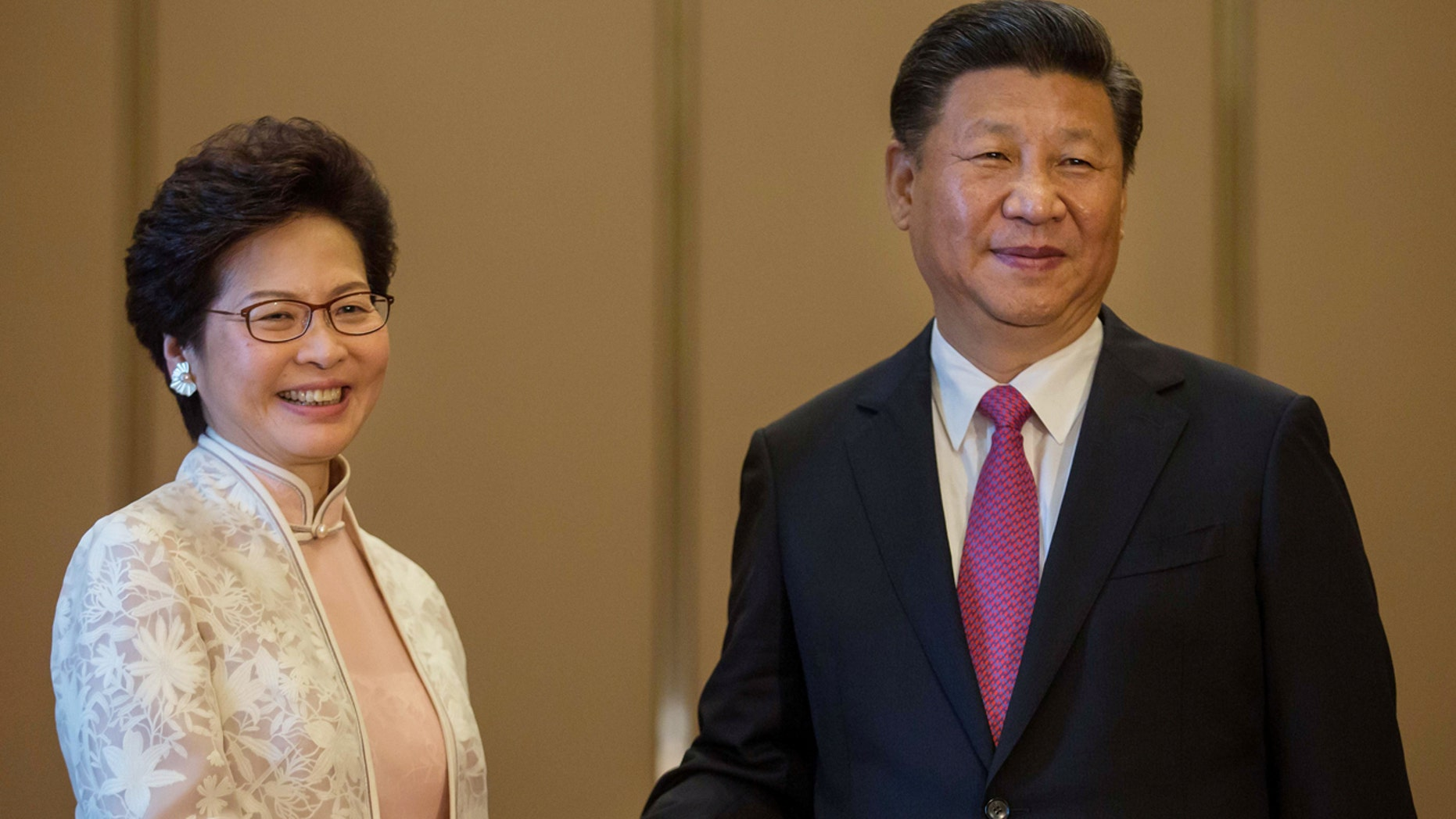 JULY 1: China's President Xi Jinping shakes hands with Hong Kong's Incoming Chief Executive Carrie Lam ahead of a meeting in Hong Kong.