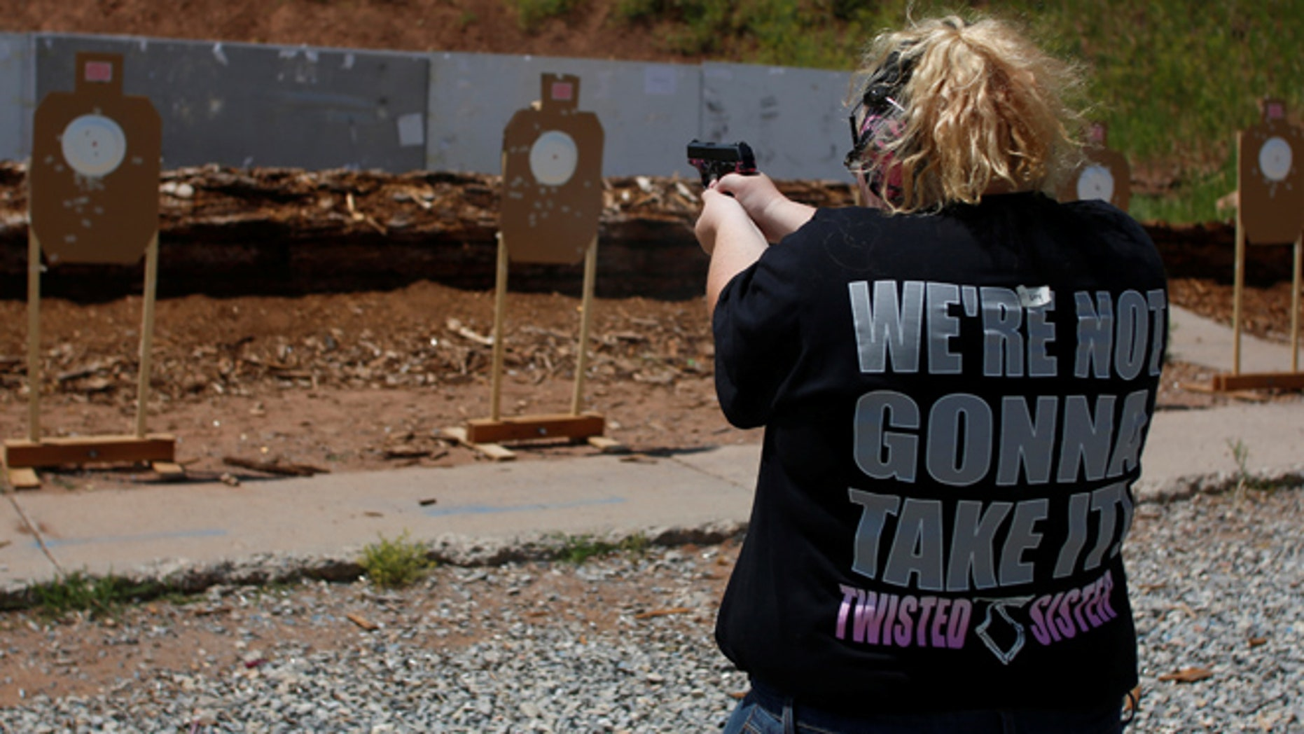 Mallory Washburn shoots at targets during a firearms training class attended by members of the Pink Pistols, a national pro-gun LGBT organization  at the PMAA Gun Range in Salt Lake City, Utah