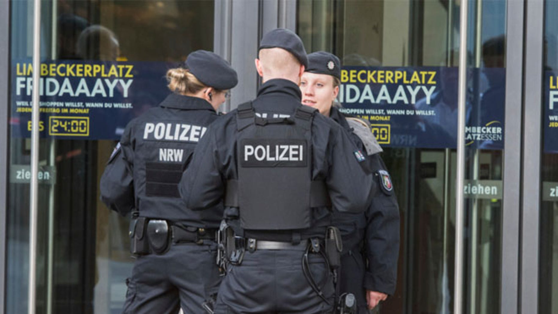 MARCH 11: Police guard in front of a shopping mall in Essen, Germany