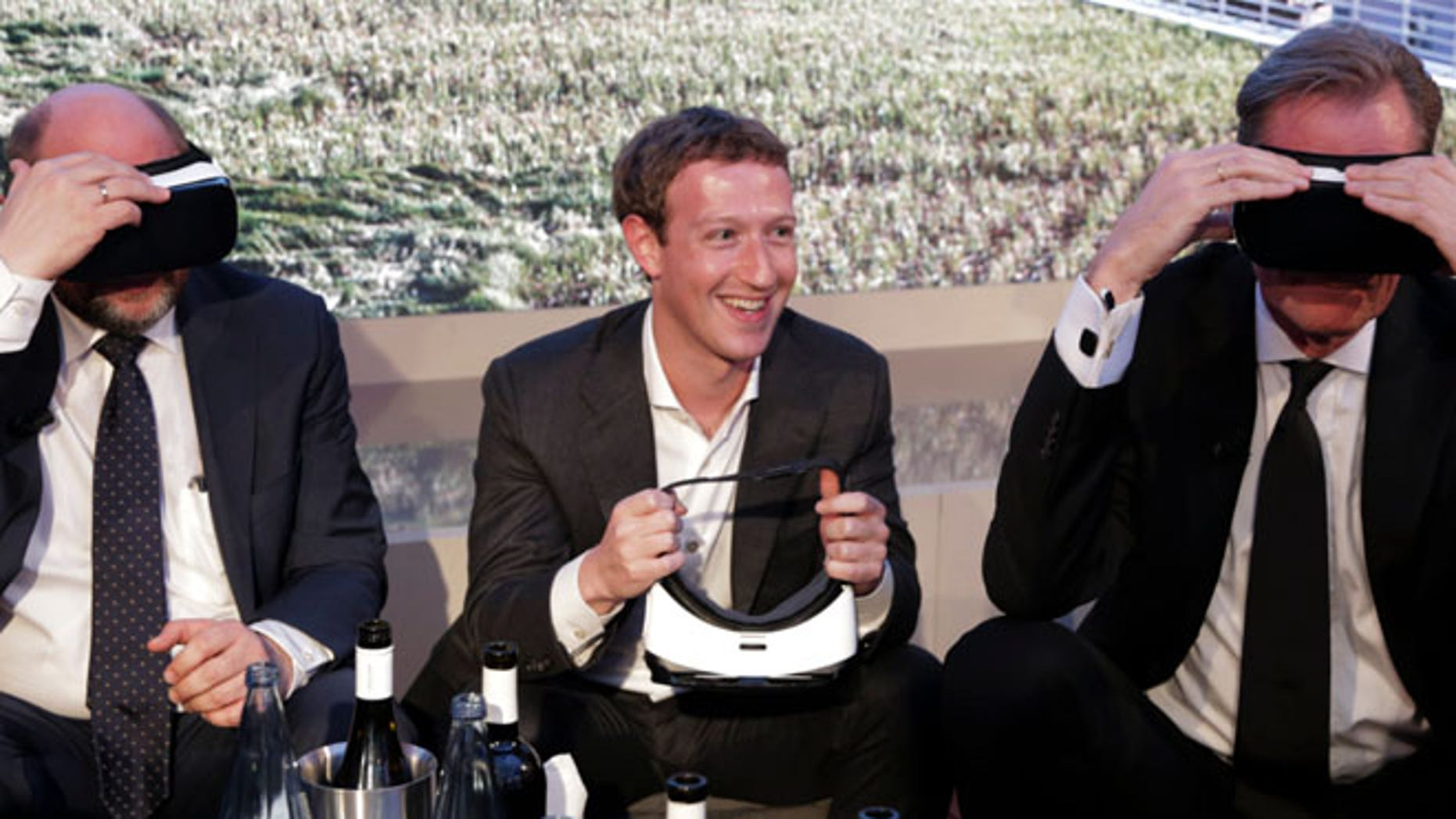 Martin Schulz, President of the European Parliament, Facebook founder and CEO Mark Zuckerberg, Mathias Doepfner, CEO of Axel Springer SE and publisher Friede Springer (L-R) try Gear VR virtual reality headsets during the awards ceremony of the newly established Axel Springer Award in Berlin