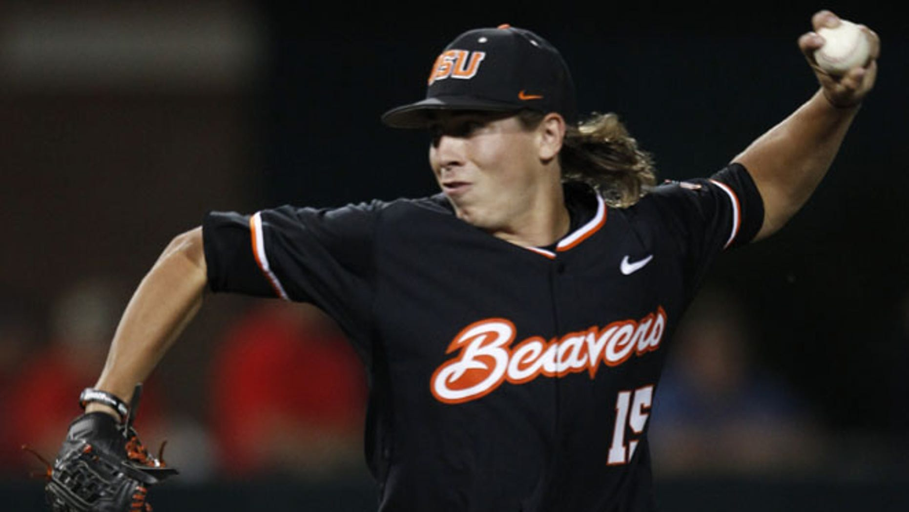 In this May 31, 2015, Oregon State's Luke Heimlich pitches to a Dallas Baptist batter during the third inning of an NCAA college baseball tournament regional game in Dallas, Texas.