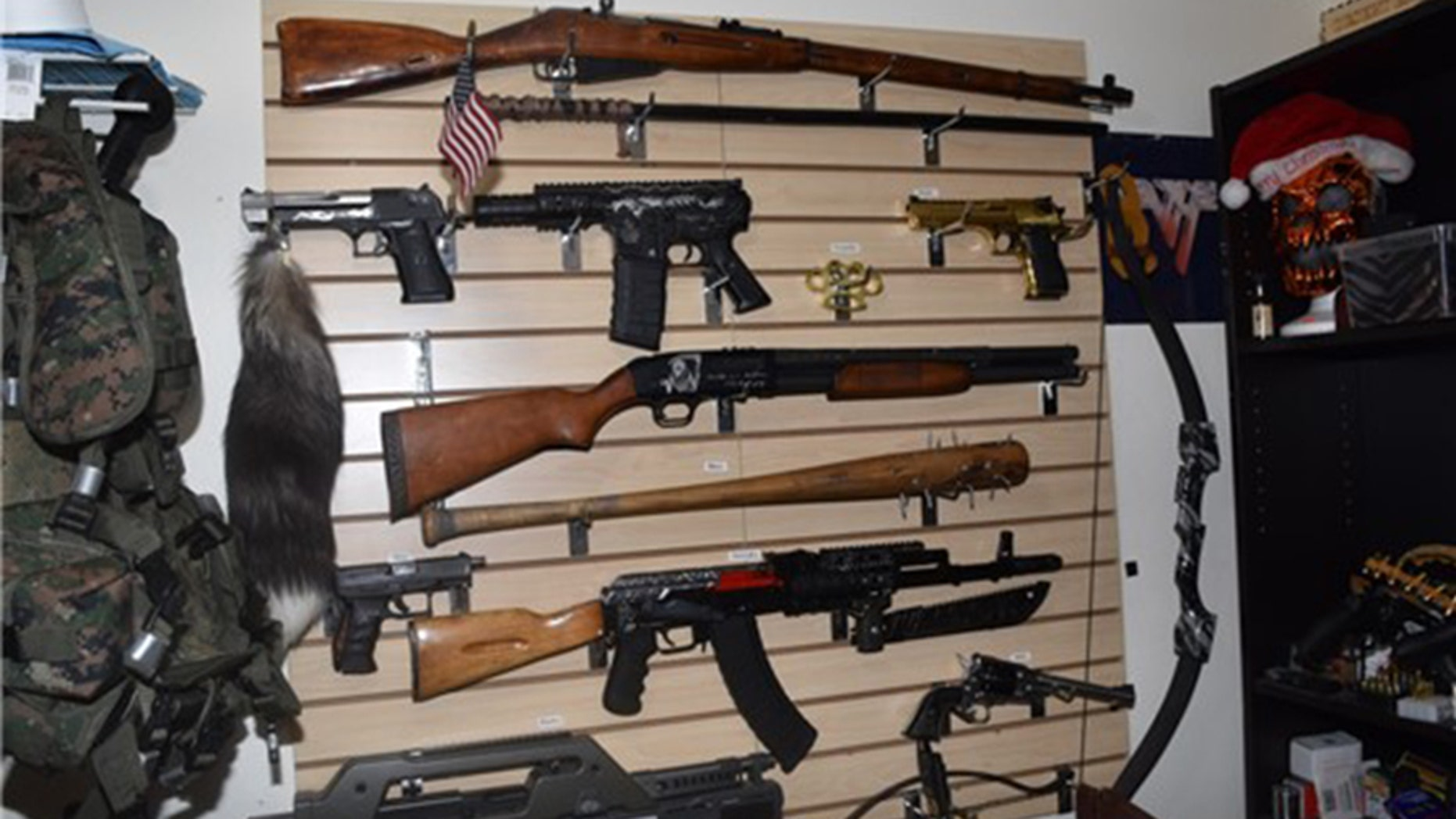 Deputies say these weapons were found in a closet belonging to Randall Drake, 24, in Dunedin, Florida.