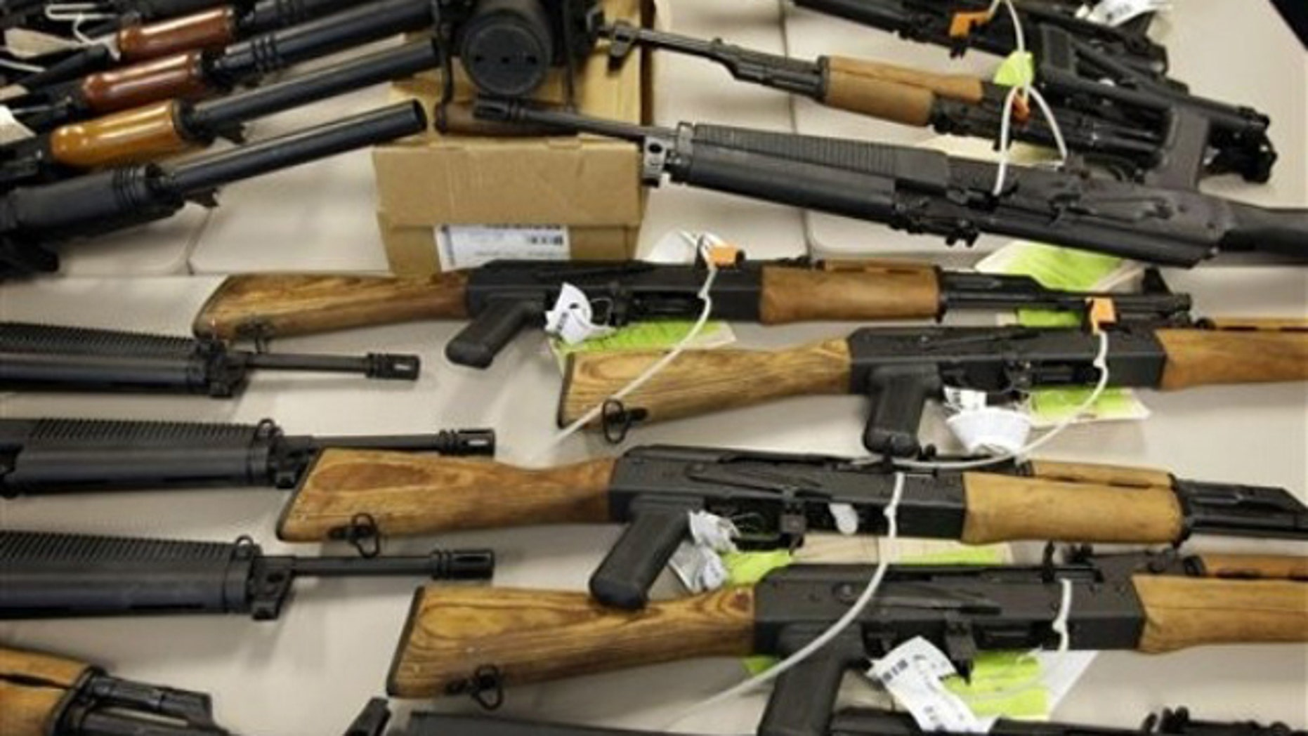 FILE: Jan. 25, 2011:  Part of a cache of seized weapons displayed at a news conference in Phoenix.