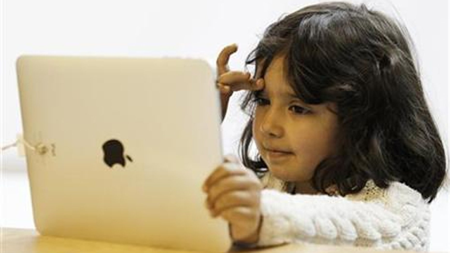 A girl views a new iPad tablet computer at an Apple store during its UK launch in central London May 28, 2010.