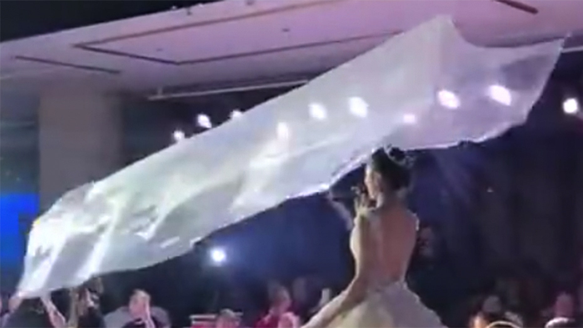 The flying veil trend involves weights, pulleys and ceiling rails.