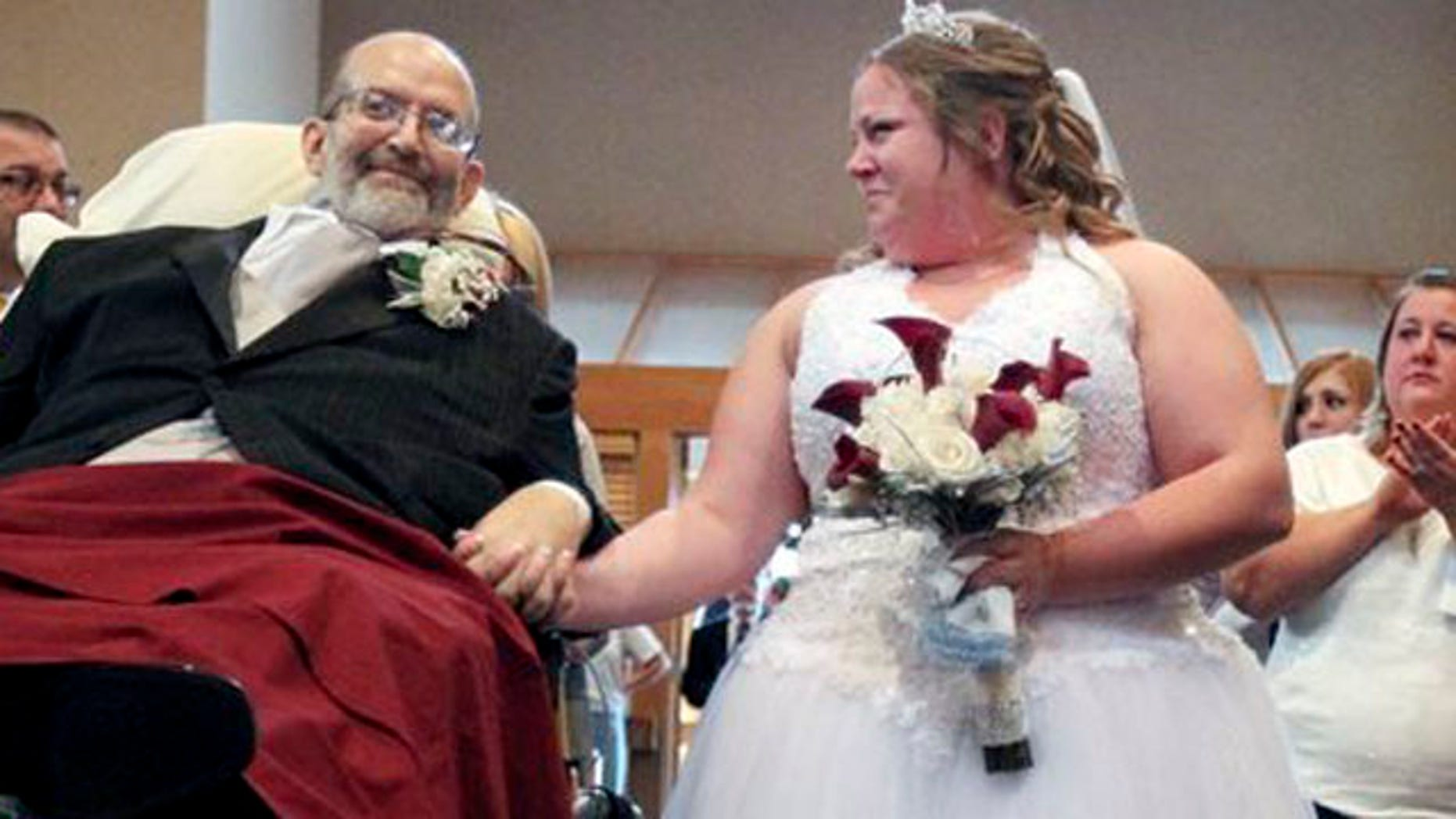 Oct. 12, 2013: Bride Sarah Nagy, right, begins to cry as she is escorted by her father, Scott, down the aisle during her wedding ceremony at First Lutheran Church in Strongsville.