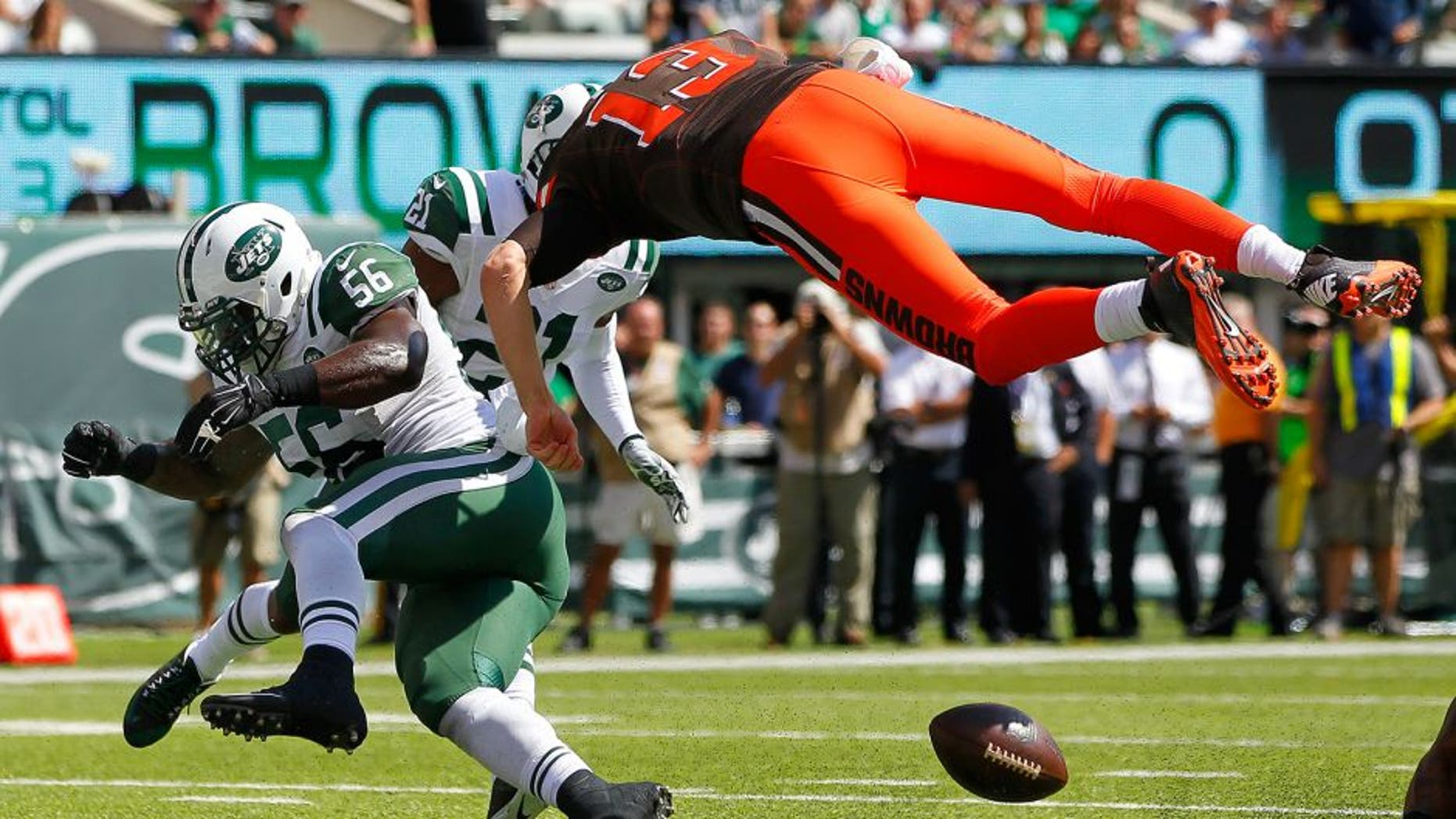 EAST RUTHERFORD, NJ - SEPTEMBER 13: Quarterback Josh McCown #13 of the Cleveland Browns fumbles at the goal line after being hit by Demario Davis #56 of the New York Jets during the first quarter at MetLife Stadium on September 13, 2015 in East Rutherford, New Jersey. The Jets won 31-10. (Photo by Rich Schultz /Getty Images)