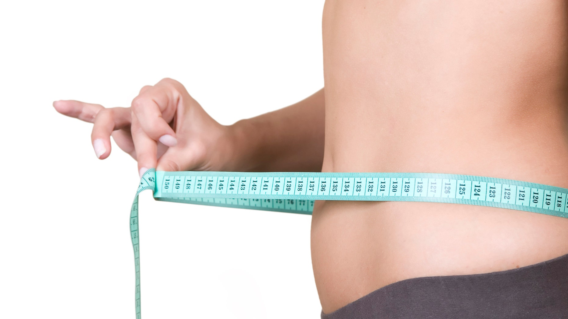 """Woman body part measuring waist, healthy lifestyle concept"""