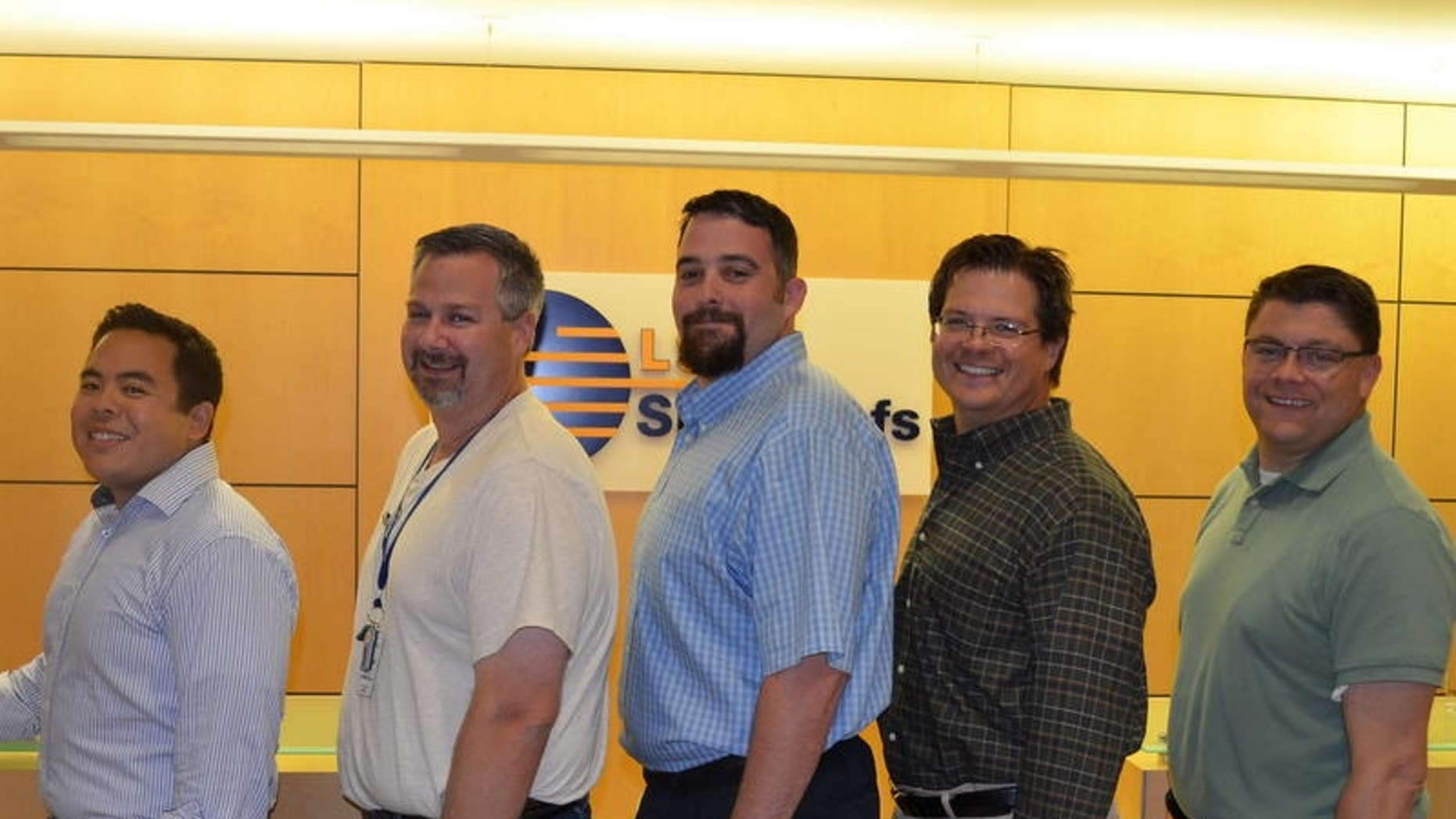 Weight-loss team members from LSG Sky Chefs: Andrew Trabosh, Neil Ylanan, Michael Sutter, Andrew Davis, Ben Levine. The team lost a total of 266 pounds or 19.10 percent.