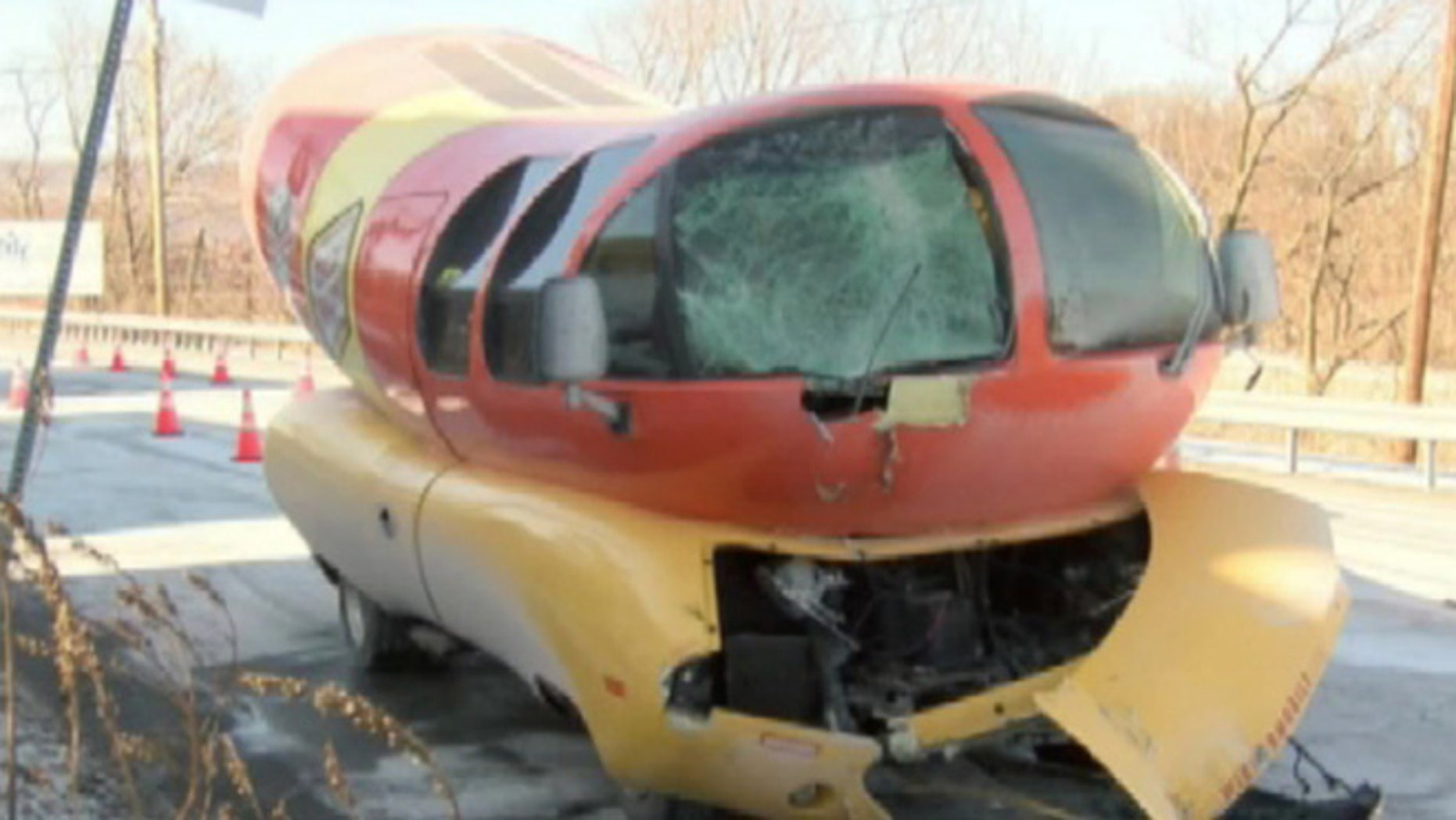 This dog had its day.  Officials say the giant hot dog on wheels slid off a road and slammed into a pole.