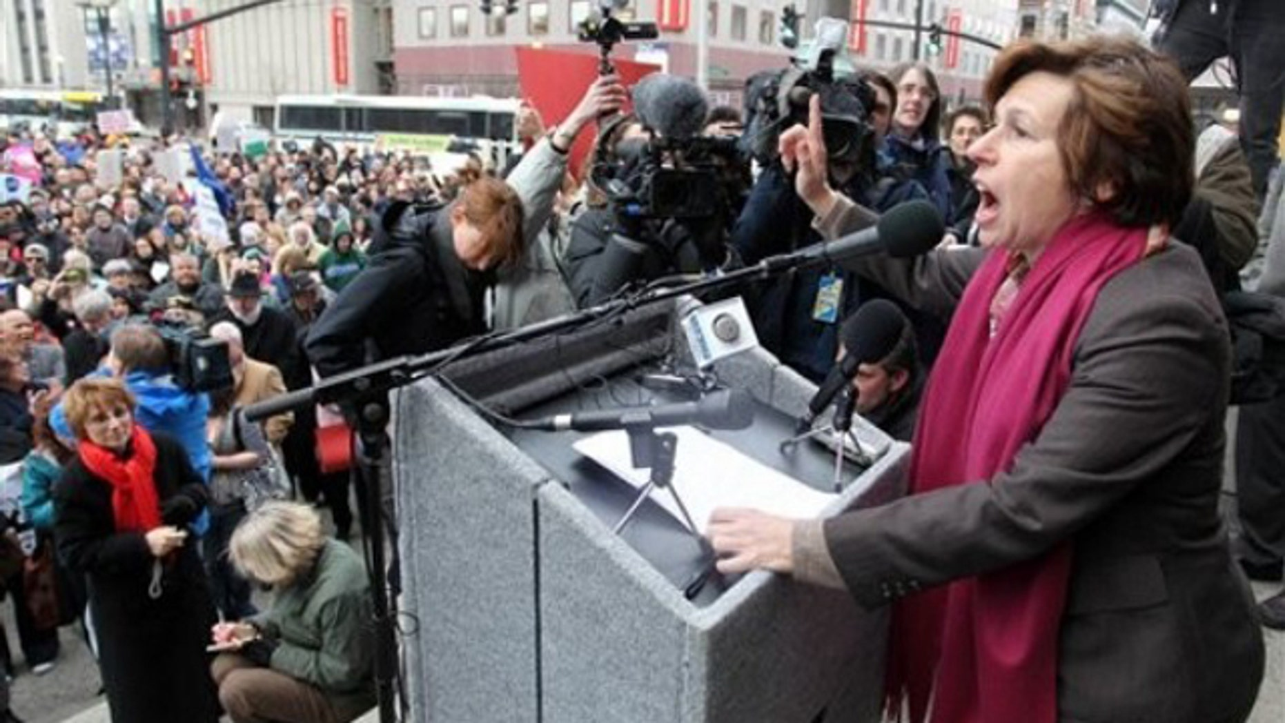 Randi Weingarten, right, president of the American Federation of Teachers, speaks to a crowd on the steps of Providence, R.I., City Hall March 2.