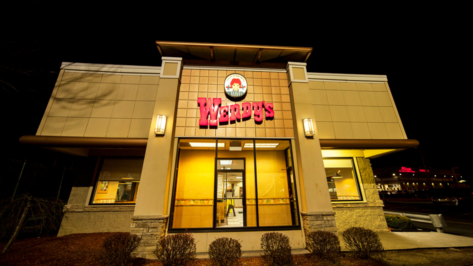New York City, NY, USA - December 17, 2014: View of Wendy's fast food restaurant in Rego Park / Forest Hills, Queens. On Metropolitan Ave.