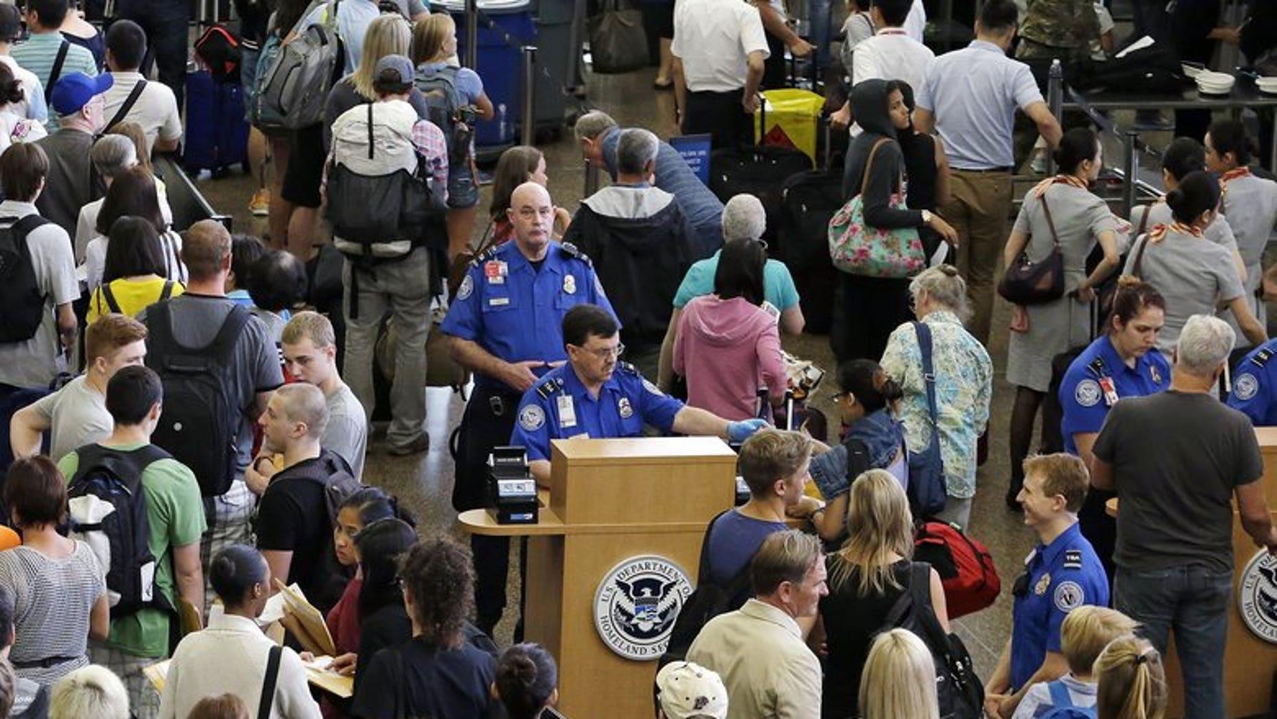 Travelers at Seattle-Tacoma International Airport wait to go through TSA security.