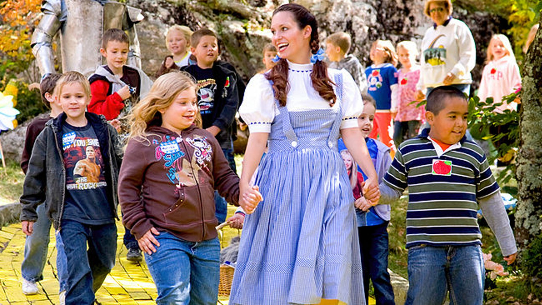 Guests follow the Yellow Brick Road with Dorothy at Land of Oz.