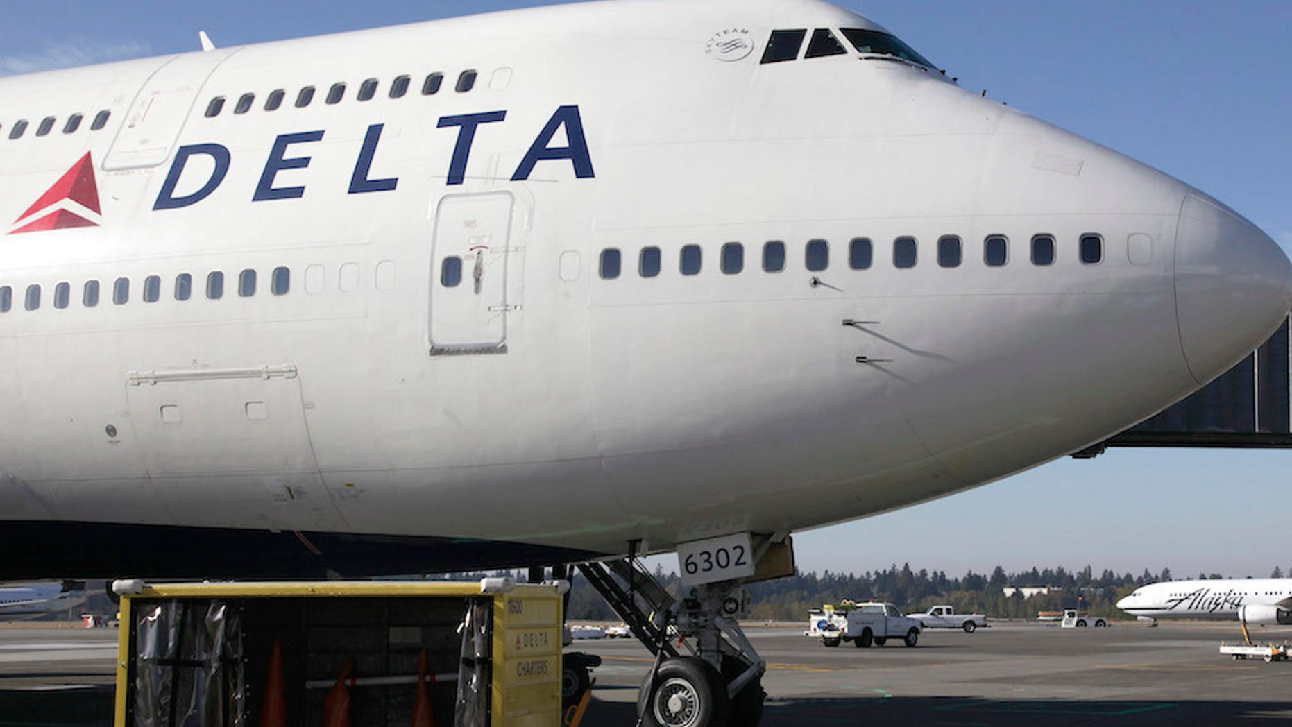 FILE - In this Oct. 8, 2012 file photo, a Delta Air Lines airplane is parked at Seattle-Tacoma International Airport in Seattle. Delta reports quarterly earnings on Wednesday, April 23, 2014. (AP Photo/Ted S. Warren File)