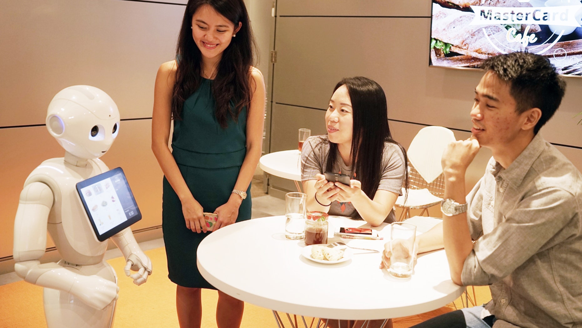 The future of fast food? Pepper, the humanoid robot, takes customer orders in a Japanese Pizza Hut.