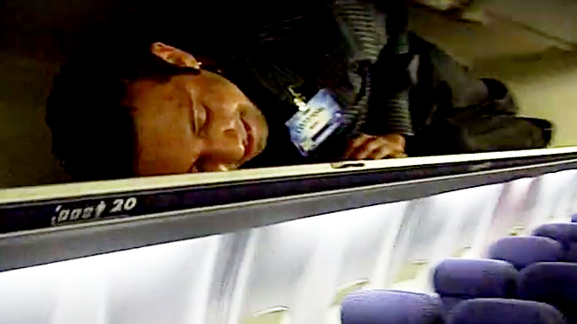 Crew members squeeze into overhead bins after passengers takeoff.