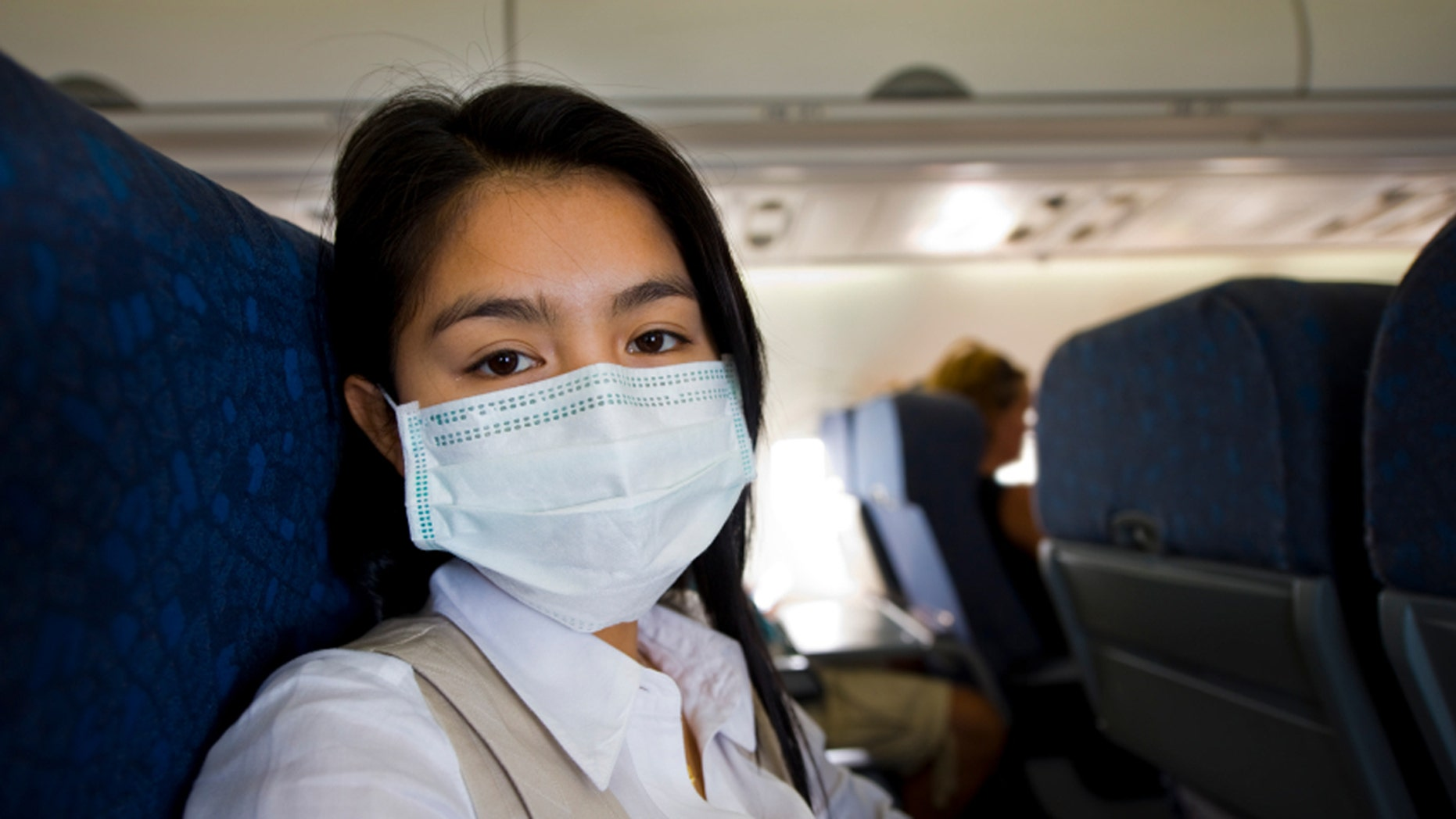 Wearing a mask may seem extreme but travelers encounter tons of germs while flying.