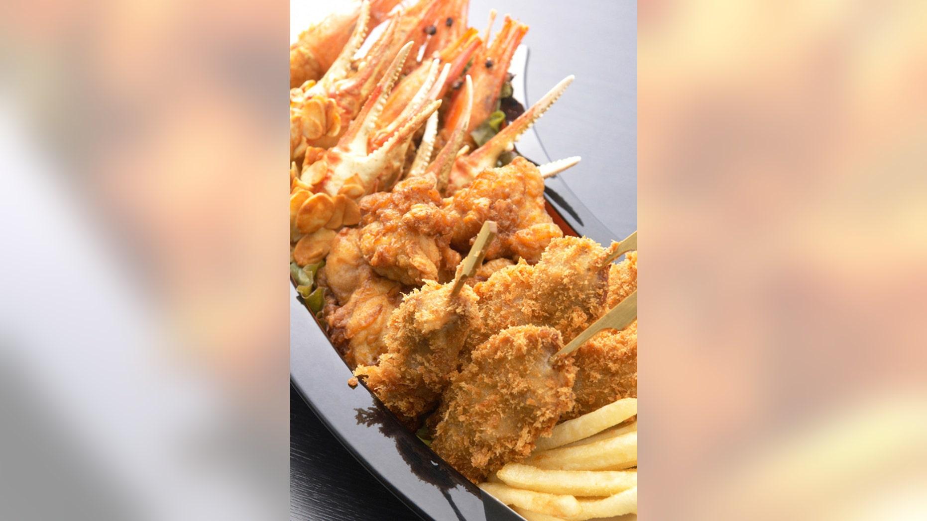 Kushikatsu, deep-fried meat and vegetable skewers, are a very popular street food in Japan.