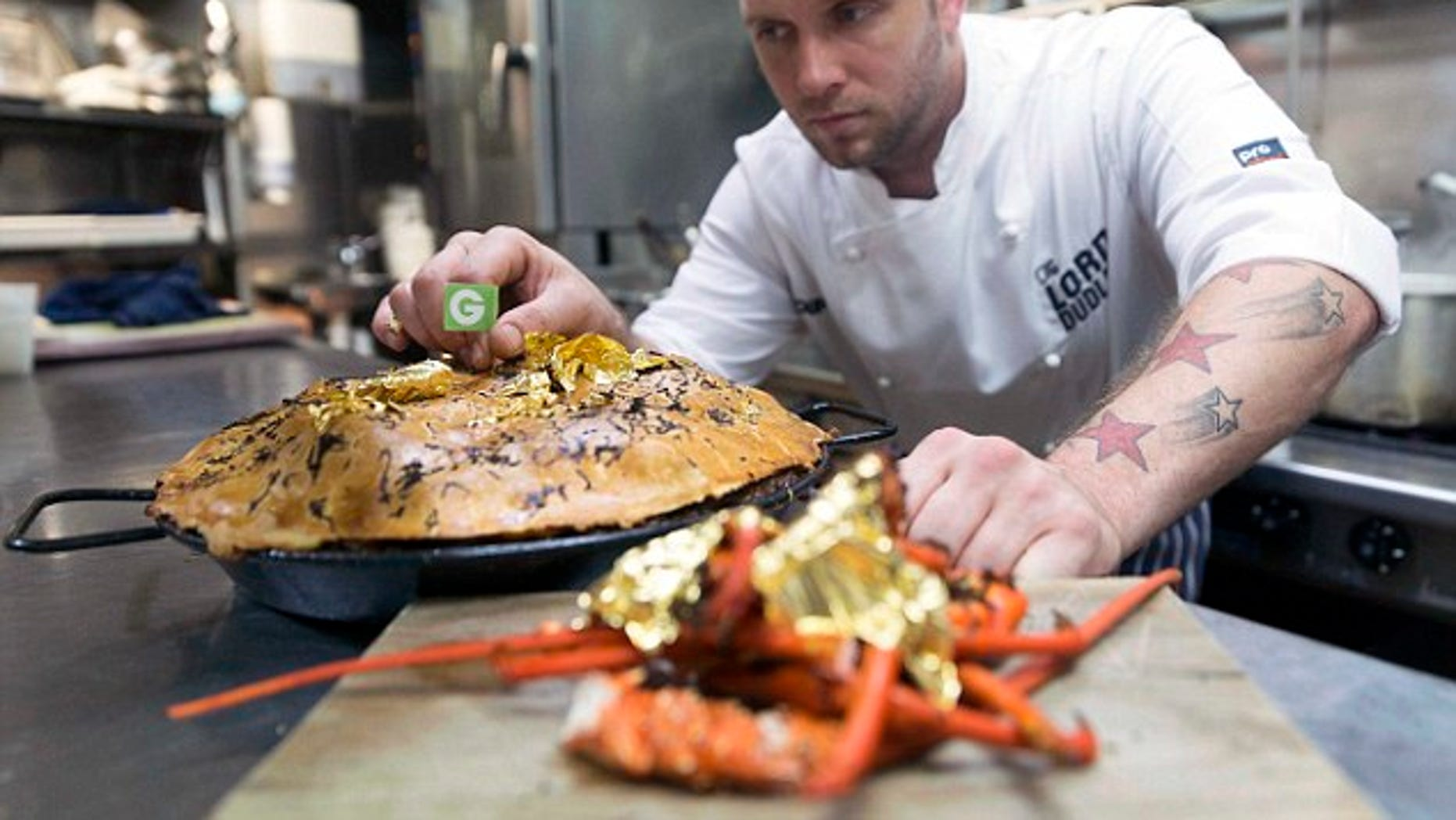 Executive chef Paul Medcalf puts the finishing touches on his five-figure creation.