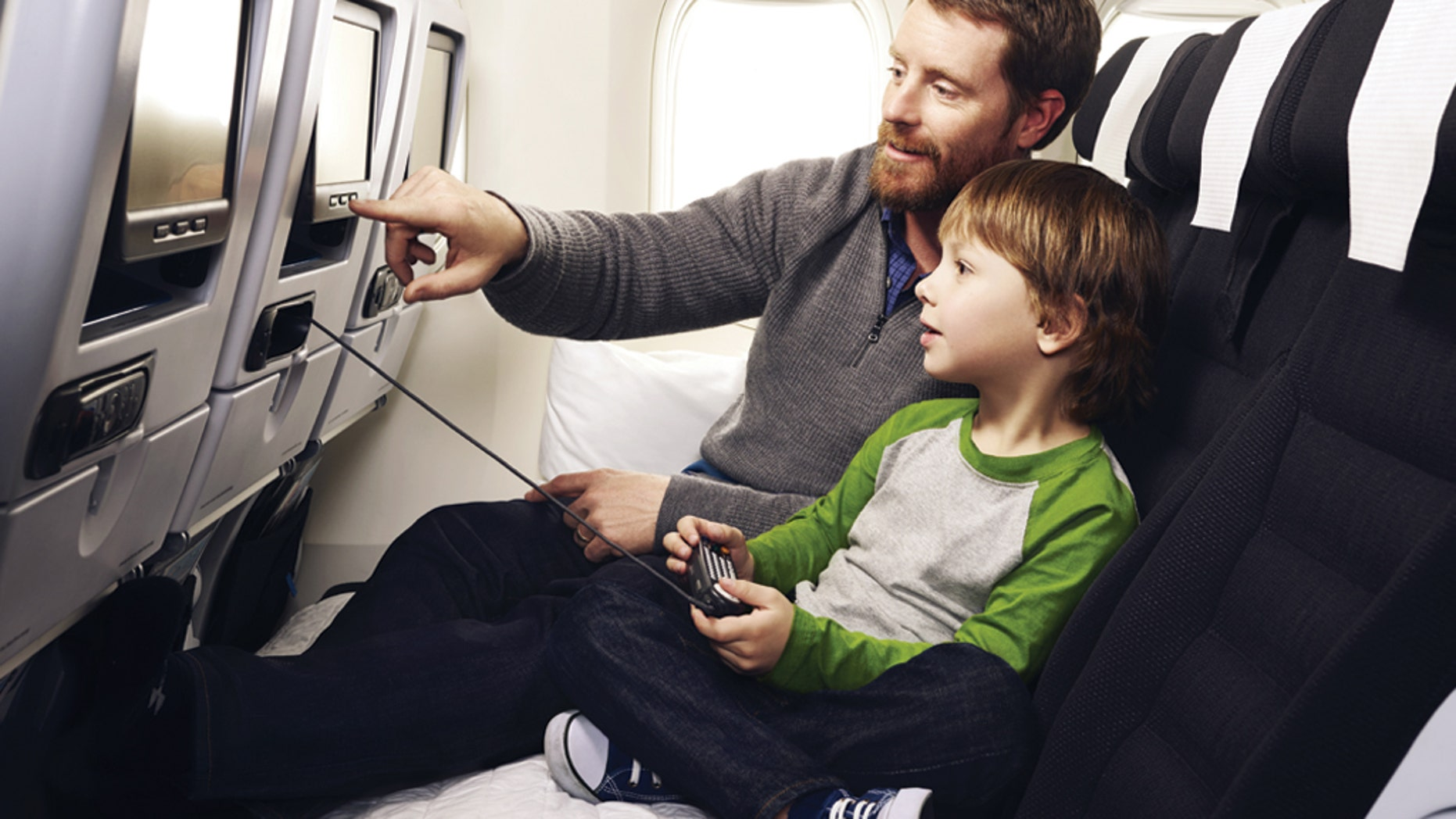 Families can cuddle up on Air New Zealand's Economy Skycouch seating.