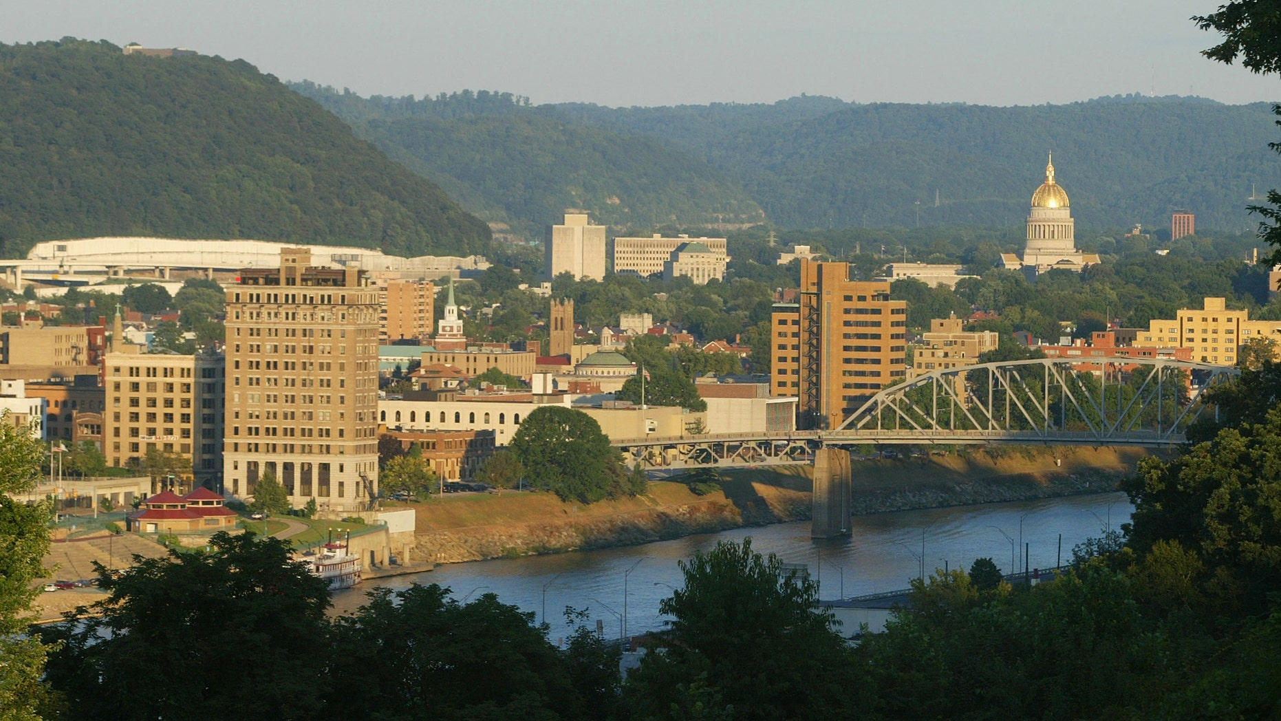 CHARLESTON, WV - AUGUST 23: The sun sets on the skyline August 23, 2003 of Charleston, West Virginia. An emergency task force of local, state and federal law enforcement agencies are trying to solve three murders, possibly by a serial sniper in and around the capital city. (Photo by Joe Raedle/Getty Images)