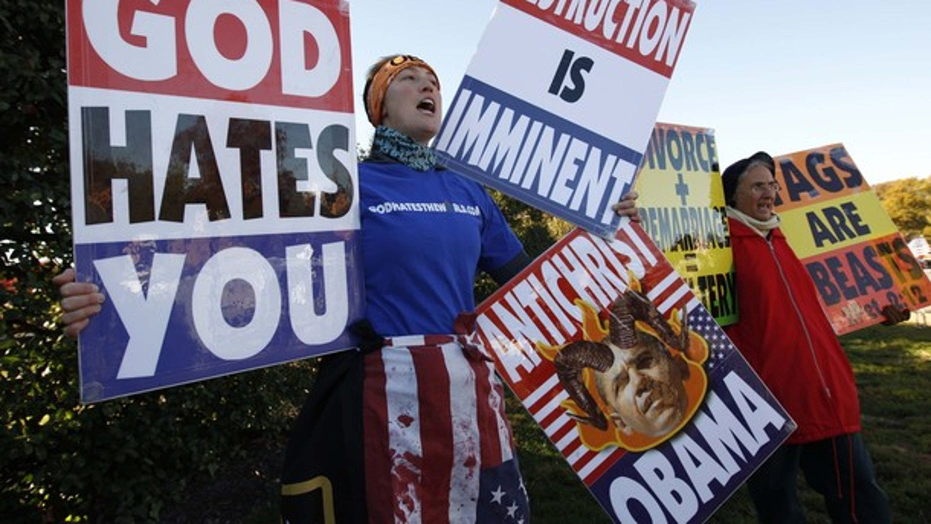 Nov. 11, 2010: Members of the Westboro Baptist Church hold anti-gay signs at Arlington National Cemetery in Virginia on Veterans Day.