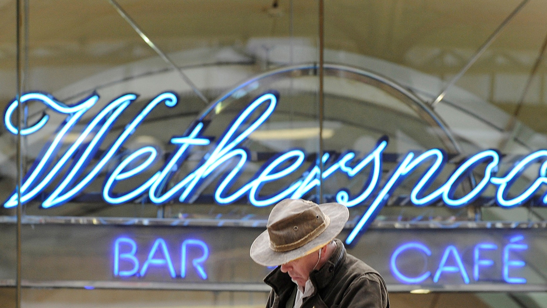 FILE PHOTO: A Wetherspoon's logo is seen at a bar in central London March 13, 2009. (REUTERS/Toby Melville//File Photo)