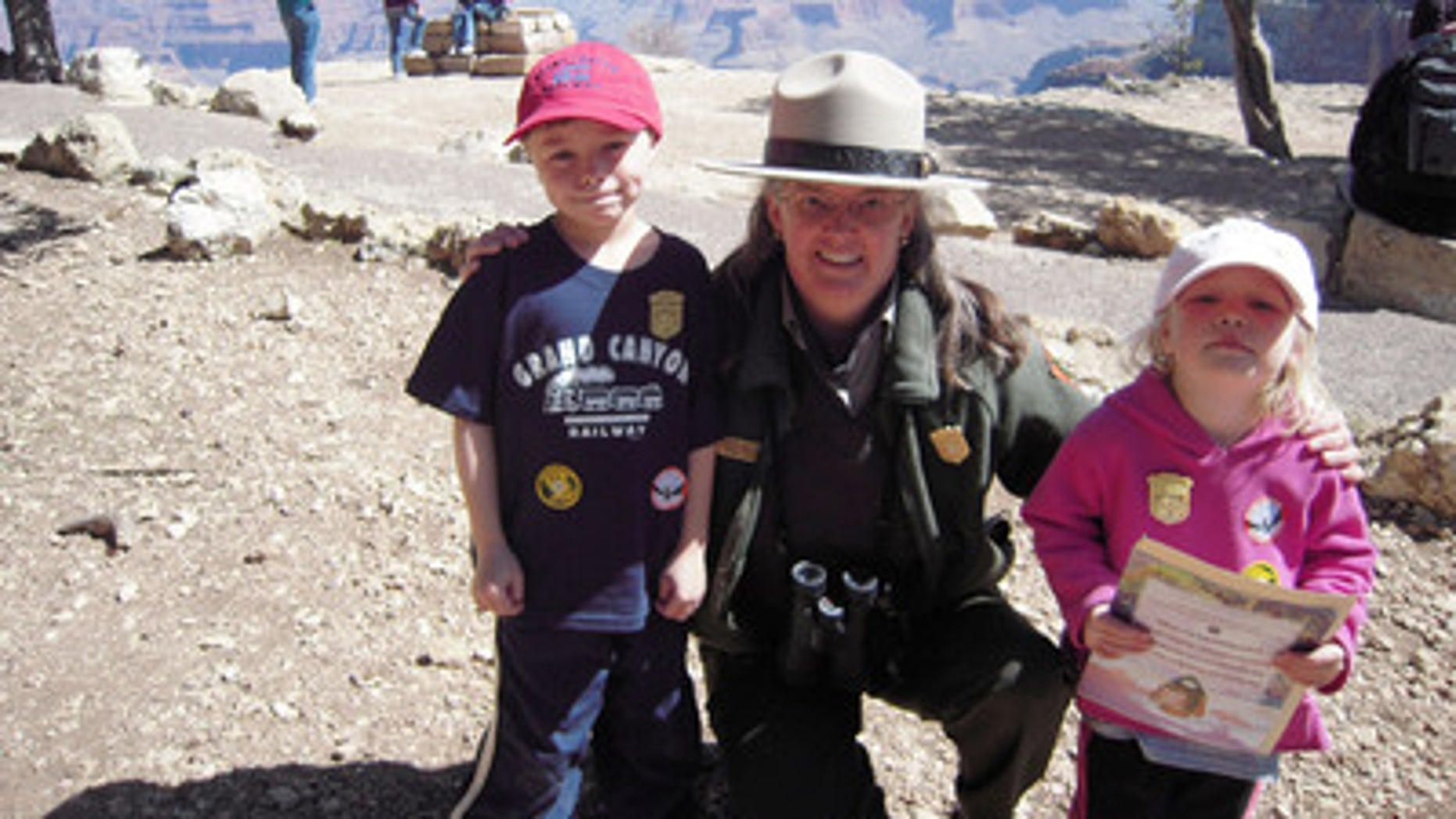 Ethan Sitzman and his sister Hannah with a park ranger at Grand Canyon. Part of the Junior Ranger program.