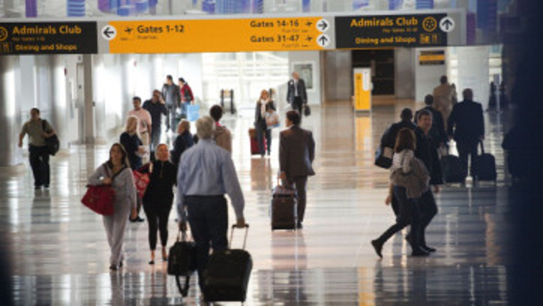 Passengers move through a JFK airport terminal.