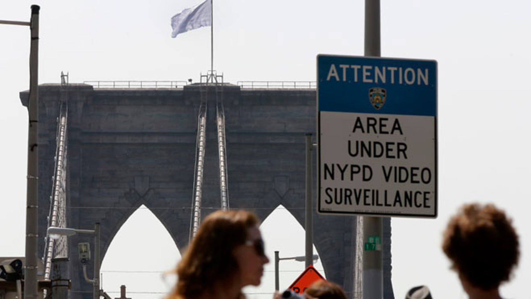 July 22, 2014: A white flag flies atop the west tower of New York's Brooklyn Bridge. The NYPD is investigating who was behind the flag switch, but one person called The Daily News claiming responsibility.
