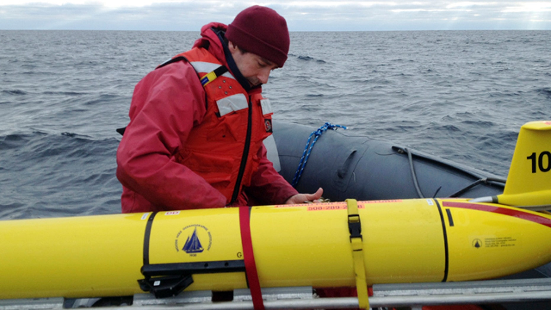 Dec. 4, 2012: Woods Hole Oceanographic Institution chief scientist Mark Baumgartner, secures an underwater robot used to collect acoustic data to help scientists locate endangered whales in the north Atlantic Ocean.