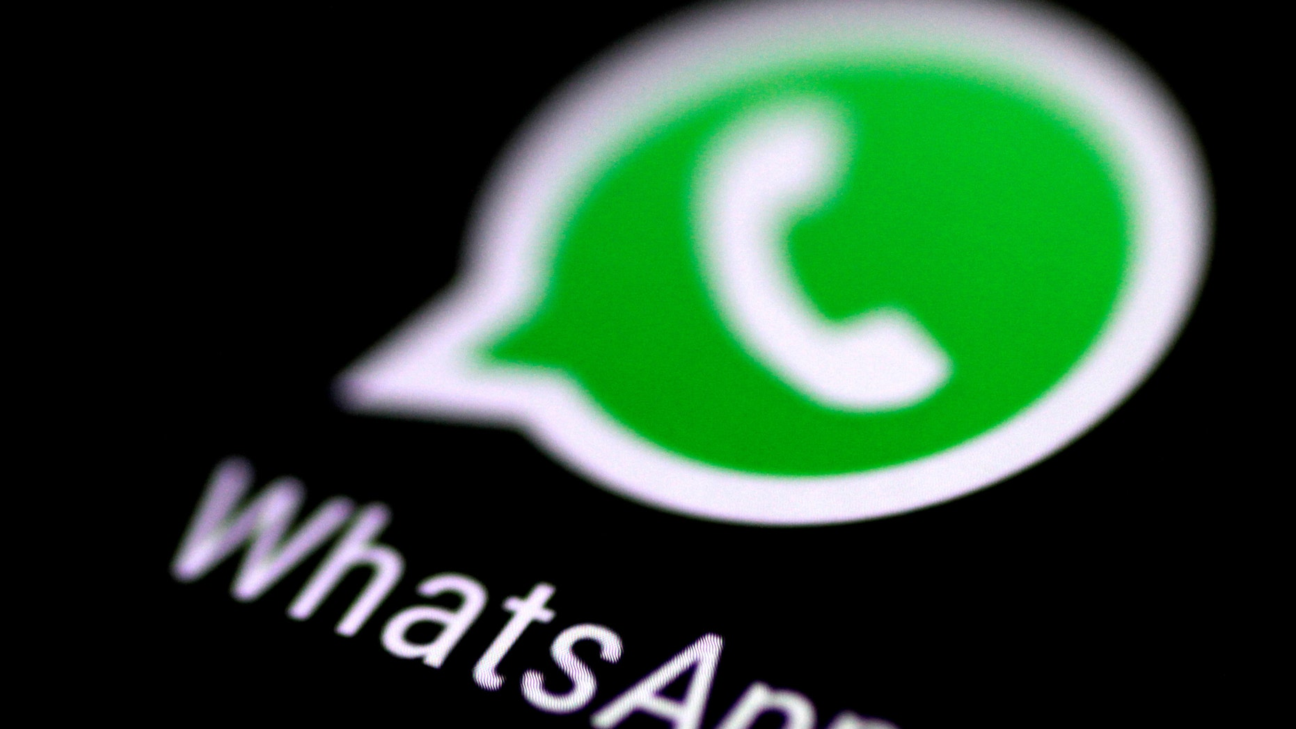 File photo: The WhatsApp messaging focus is seen on a phone shade Aug 3, 2017. (REUTERS/Thomas White)