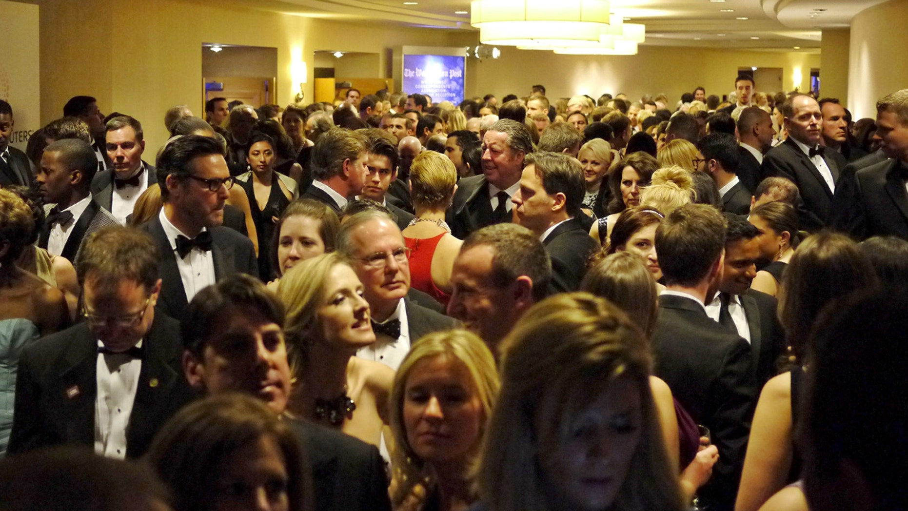People crowd into the hallways as they leave their pre-parties to go to the ballroom for the White House Correspondents' Association dinner in Washington April 25, 2015.