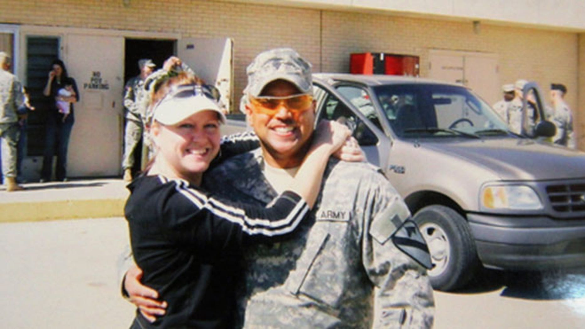 Sept. 22, 2014: Omar Gonzalez poses for a photo in his Army uniform with his former wife Samantha, prior to an overseas deployment.
