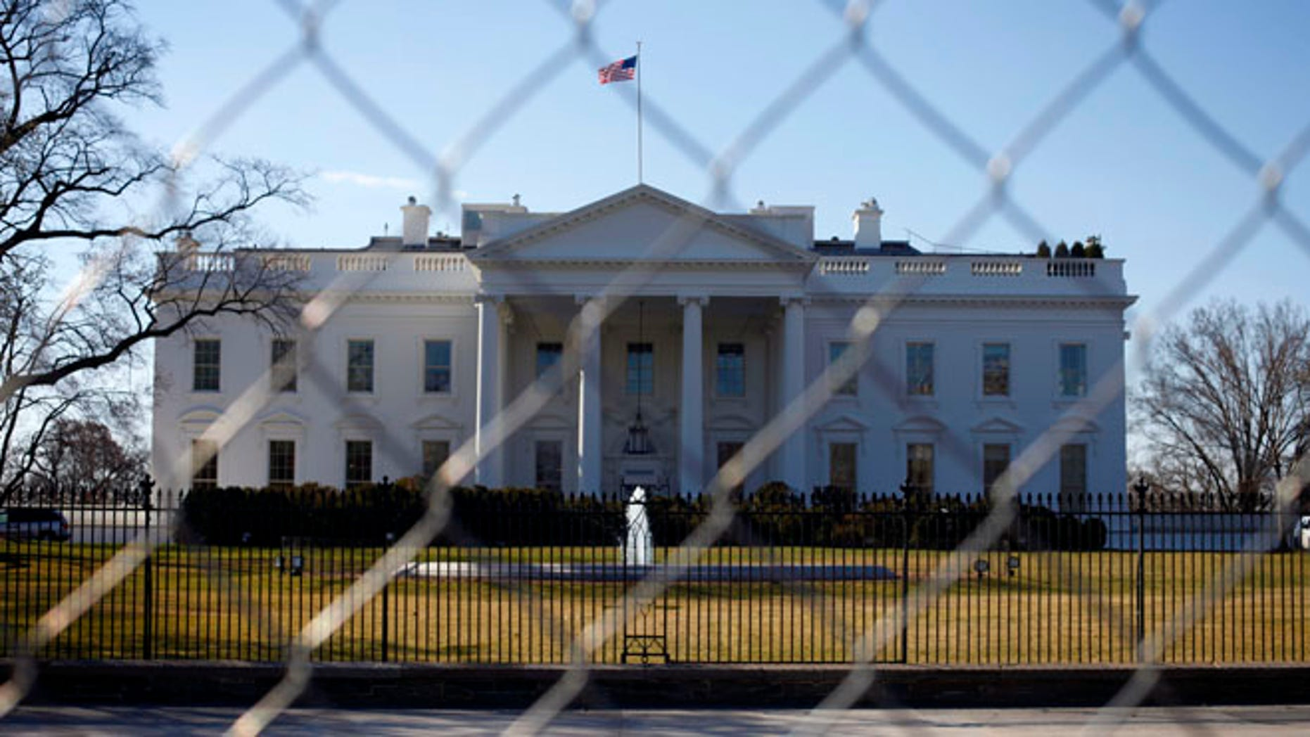 March 4, 2013: The White House is seen through a chain-link fence in Washington.