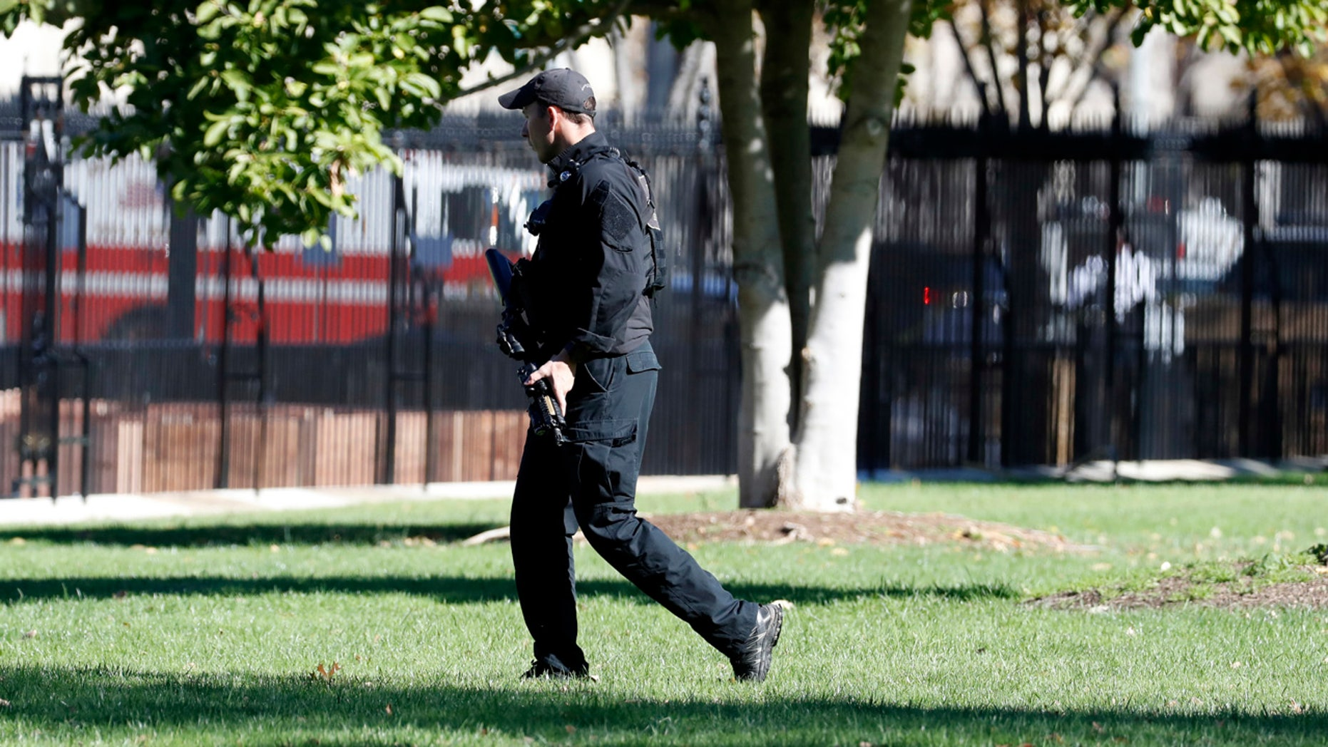 Nov. 5, 2016: A U.S. Secret Service officer walks the grounds near the North Portico during a lock-down at the White House.