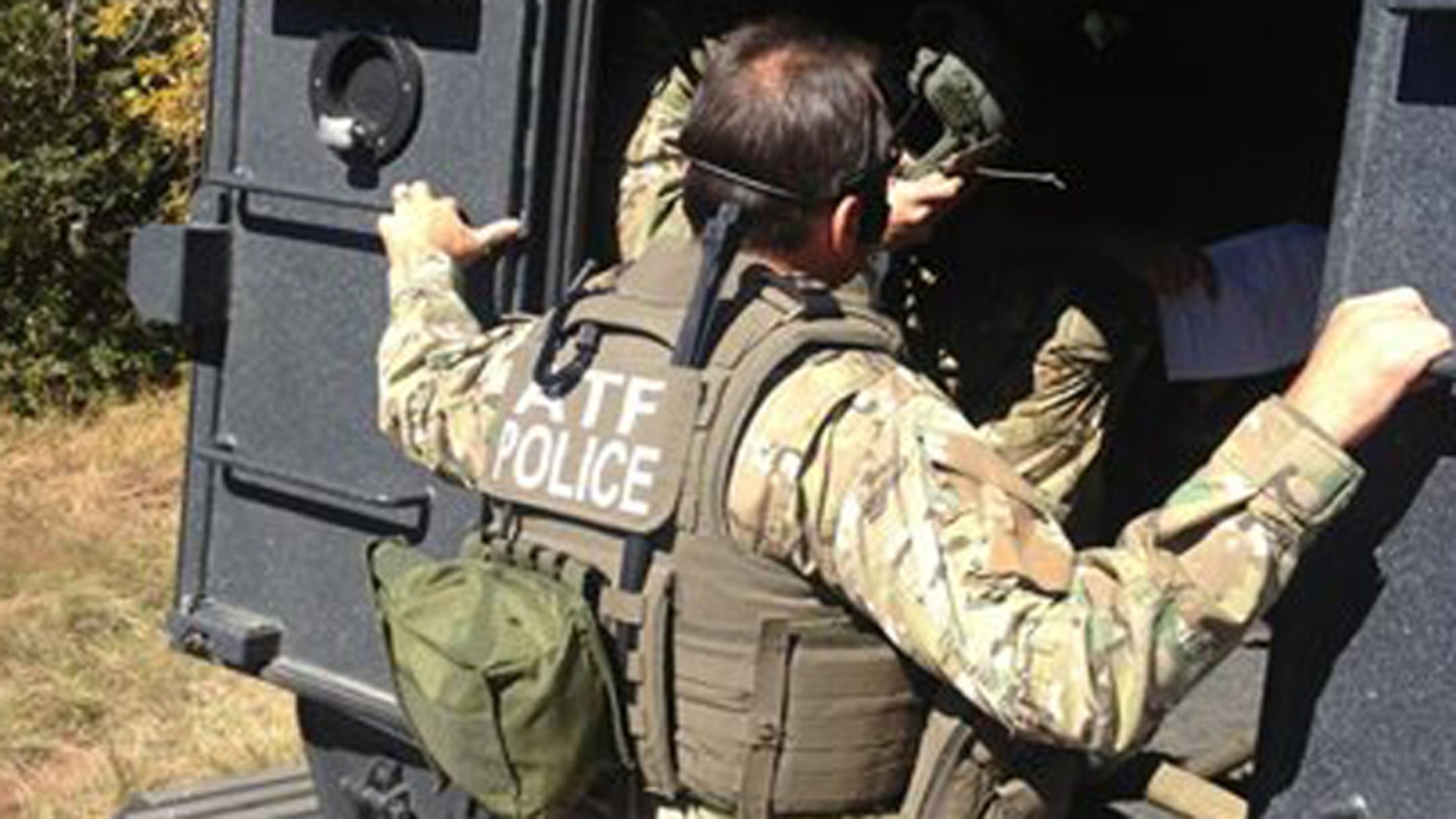 Oct. 14, 2013: Agents executing a search warrant at the home of Kirby Kehoe near Ash Fork, Ariz.