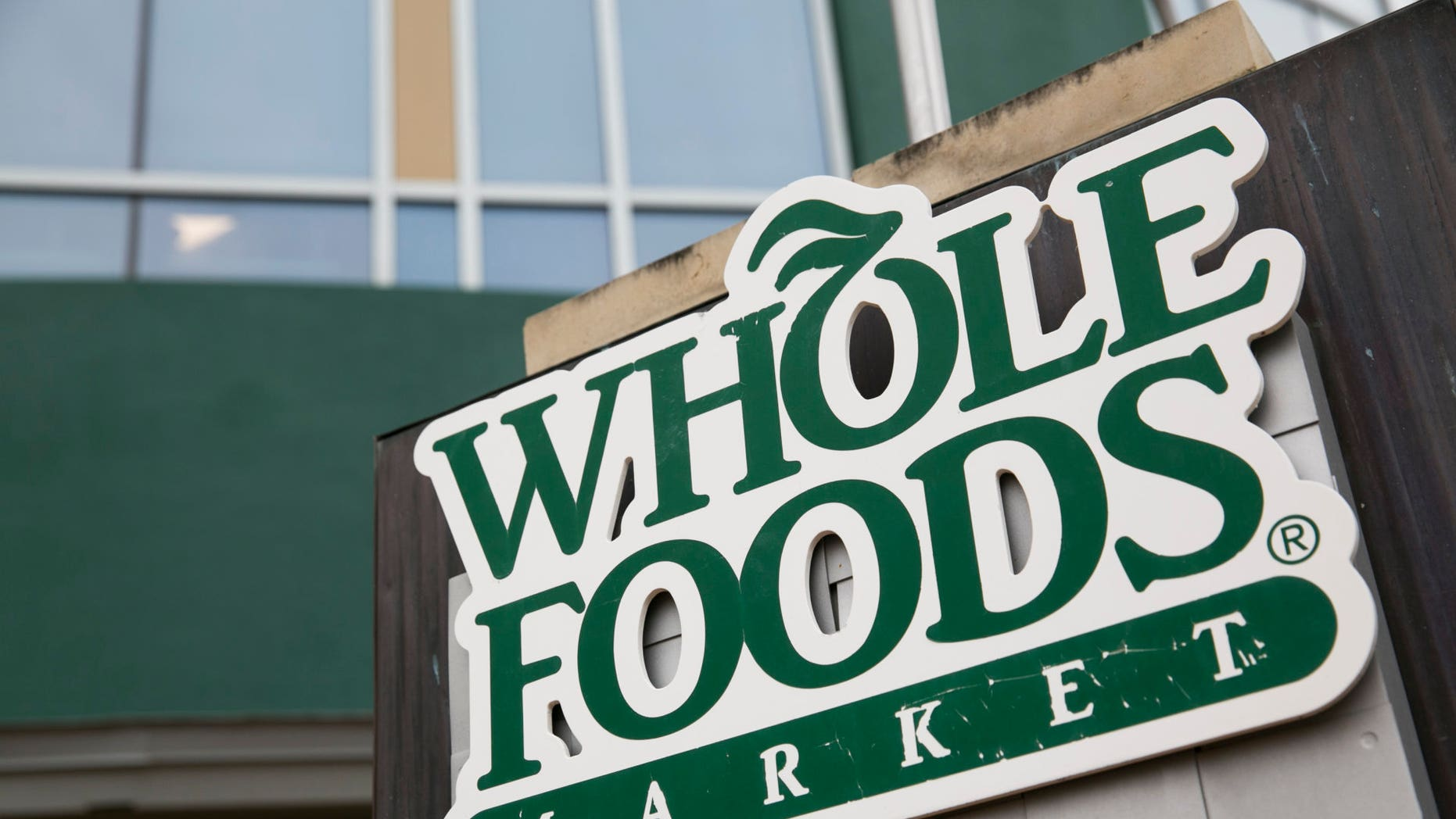 A Whole Foods store fired a security team that banned a 70-year-old customer. Photo by Kristoffer Tripplaar (Sipa via AP Images)