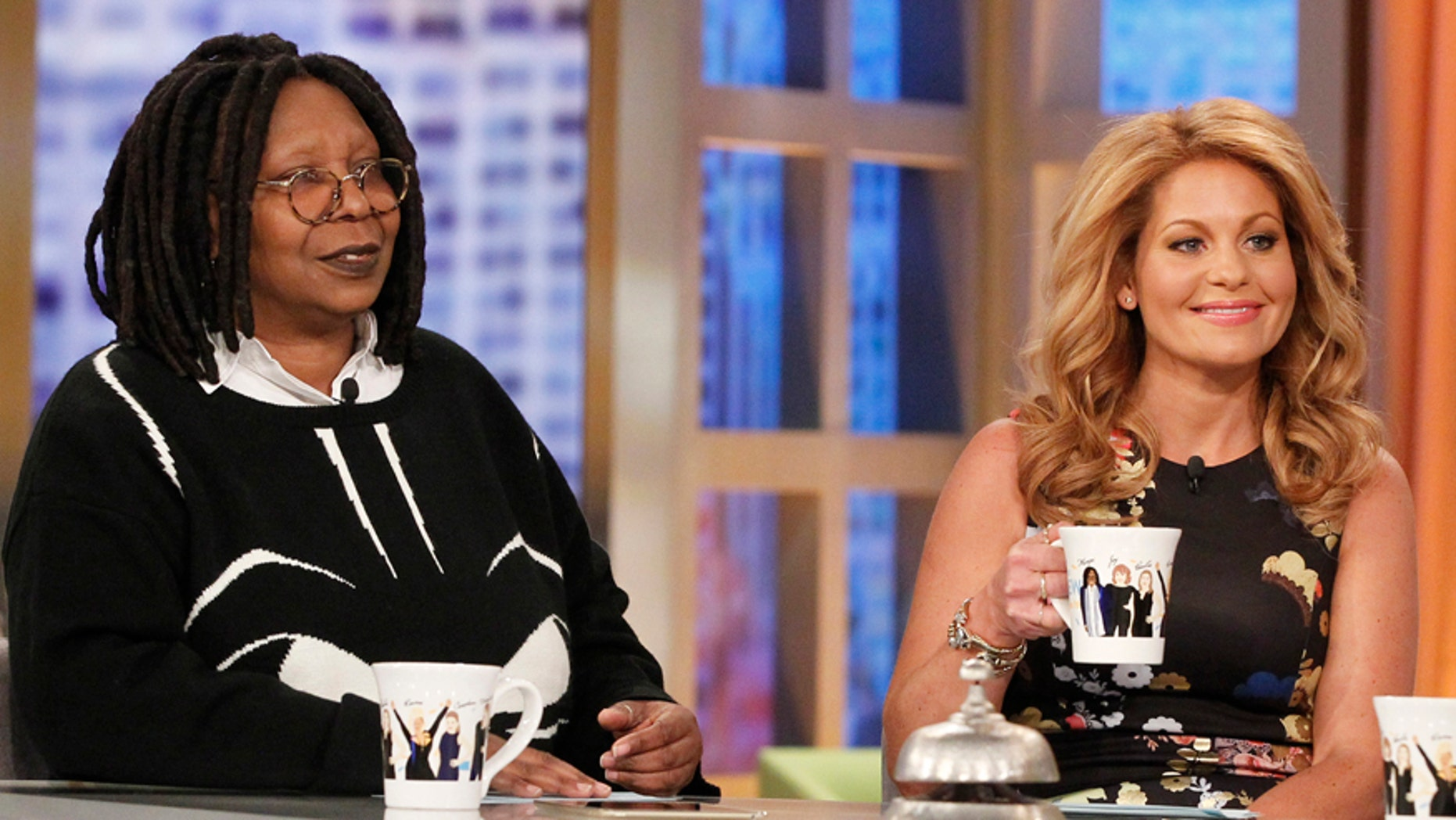 """Whoopi Goldberg, left, and Candace Cameron Bure appear on """"The View."""" (ABC/ Lou Rocco)"""