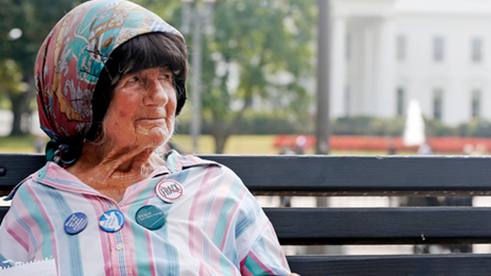 Sept. 12, 2013: Protester Concepcion Picciotto, who held a constant peace vigil in Lafayette Park across from the White House since 1981, sits on a park bench. (AP Photo/Charles Dharapak)