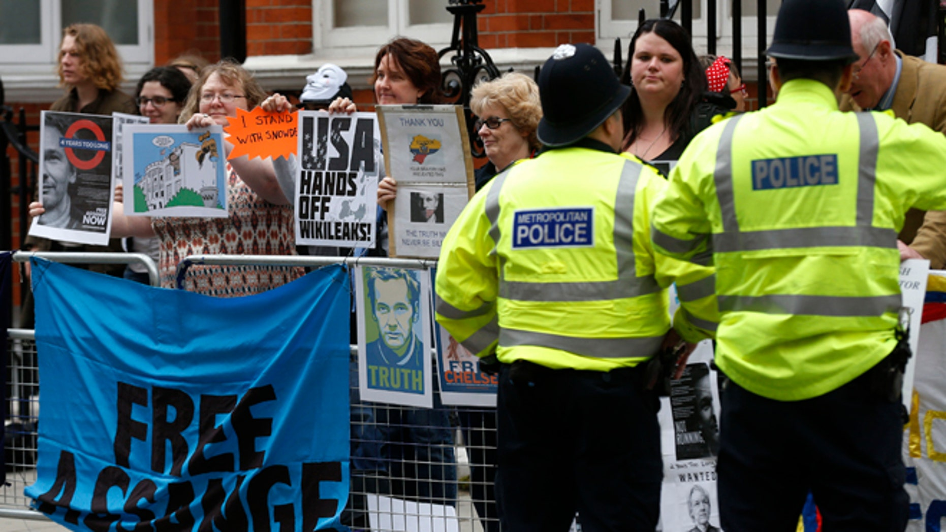 June 19, 2014: Supporters of WikiLeaks founder Julian Assange hold a vigil outside the Ecuadorian Embassy in London to mark his two years in refuge at the embassy.