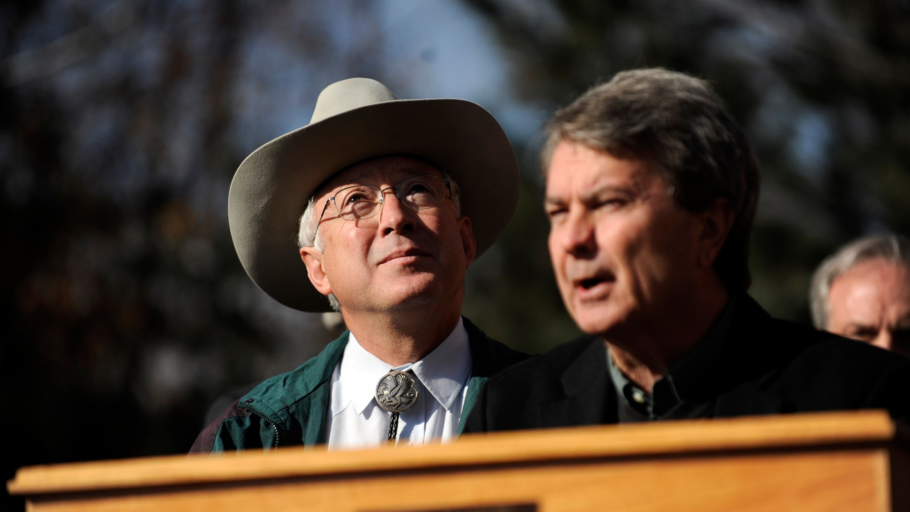 Secretary of the Interior Ken Salazar watches geese fly overhead as Bureau of Land Management Director Bob Abbey speaks about an initiative that would allow the BLM to designate and protect wilderness areas on Thursday, Dec. 23, 2010 outside of REI in Denver. (AP)