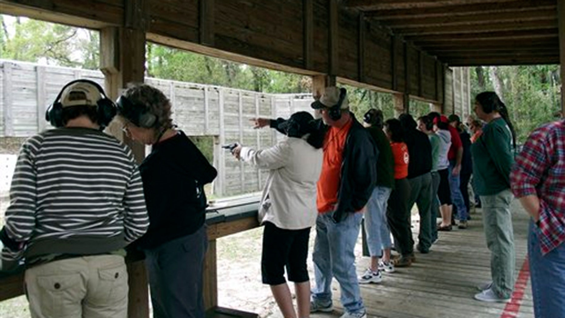 """March, 2012:  The Florida Fish and Wildlife Conservation Commission shows participants in a """"Becoming an Outdoors-Woman"""" workshop learning handgun shooting skills at the Ocala Conservation Center and Youth Camp in Ocala National Forest, Florida."""
