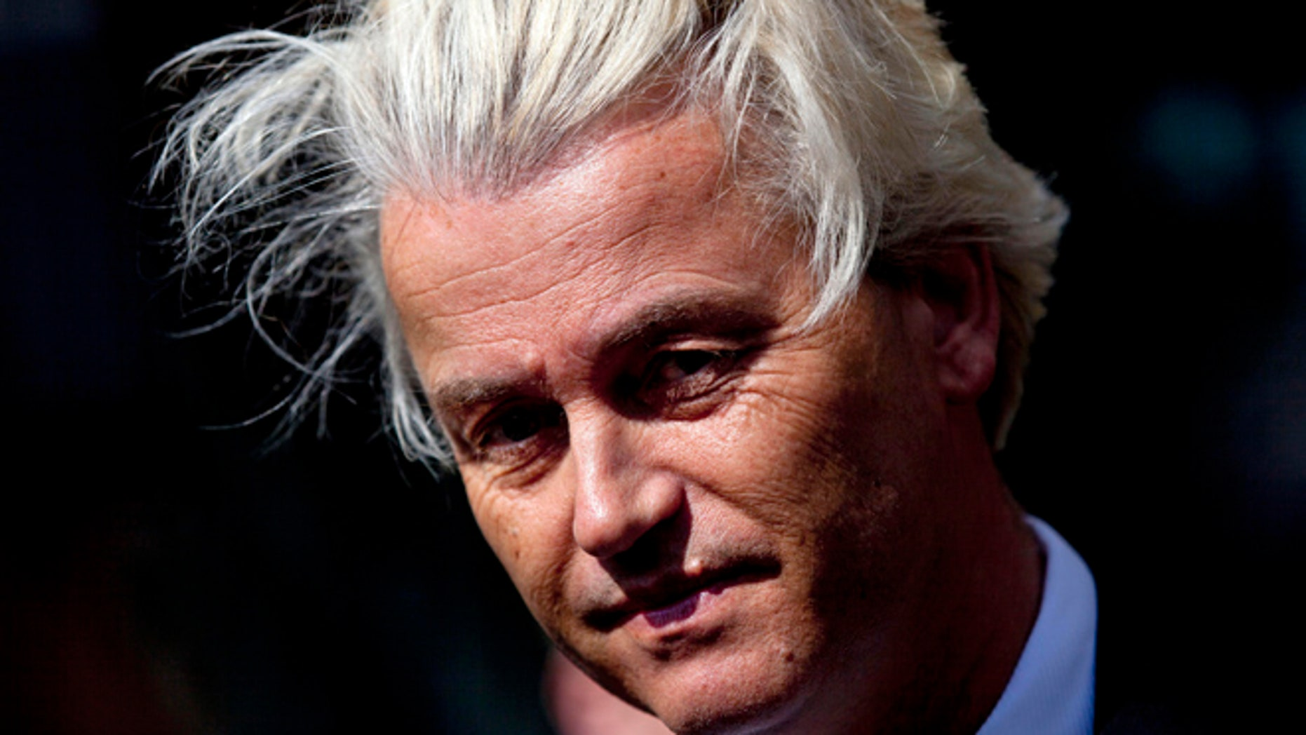 May 12, 2014: Dutch lawmaker Geert Wilders pauses, as he speaks to journalists outside the Dutch National Bank in Amsterdam.