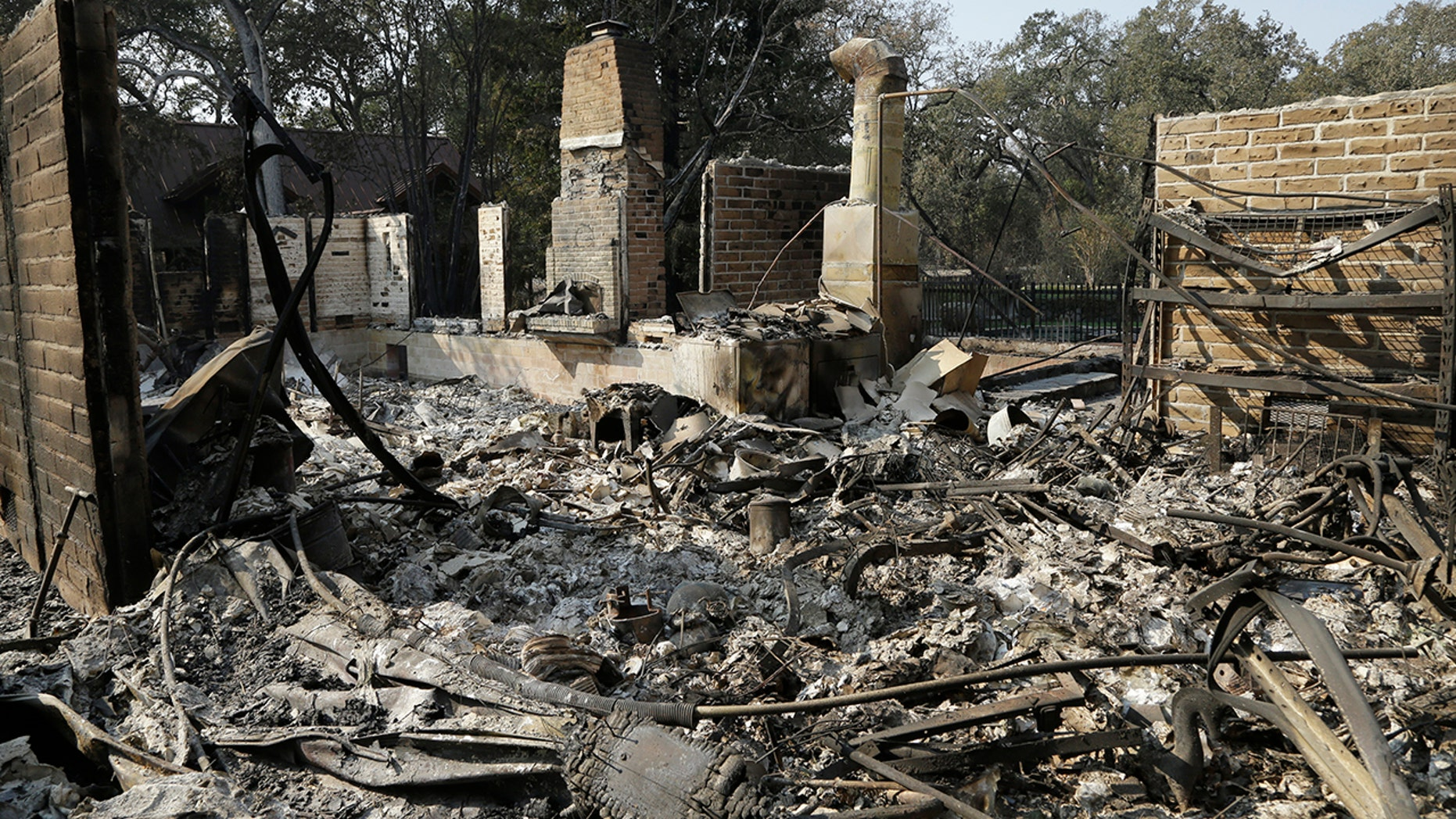 Remains of a home destroyed by wildfires seen Wednesday, Oct. 18, 2017, in Glen Ellen, Calif.