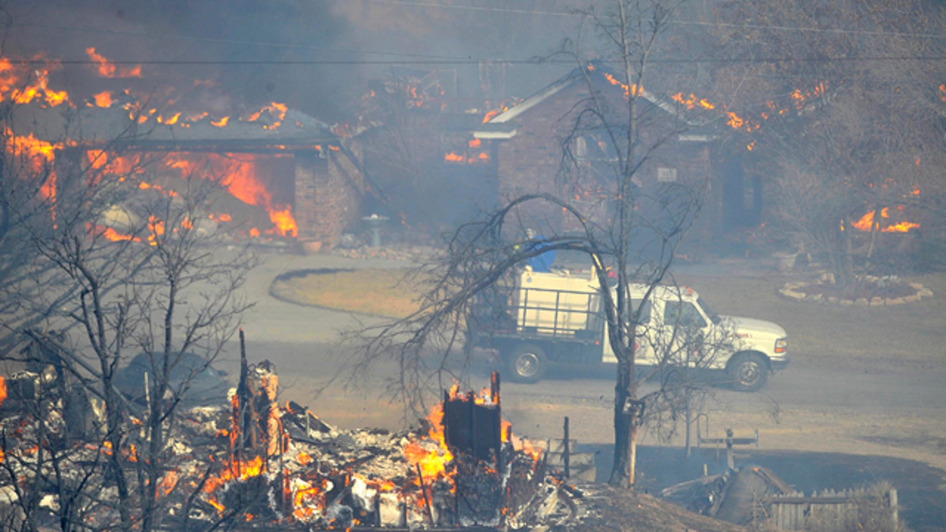 Feb. 27, 2011: Two homes in the Lake Tanglewood area in Texas burn to the ground as emergency personnel can do nothing but watch. Texas Forest Service spokesman Lewis Kearney said two wildfires joined about five miles south of Amarillo to destroy or damage the almost two dozen homes.